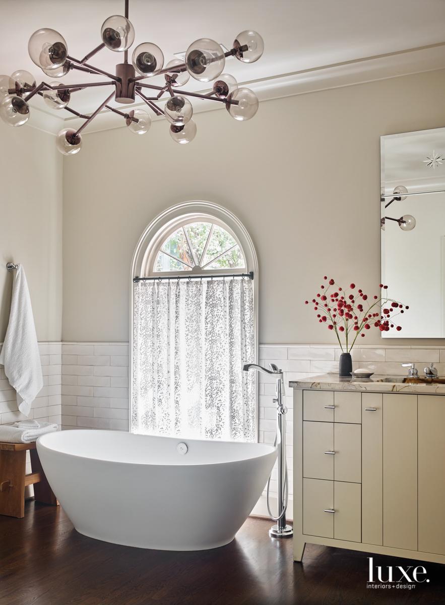 neutral bathroom with elliptical soaking...