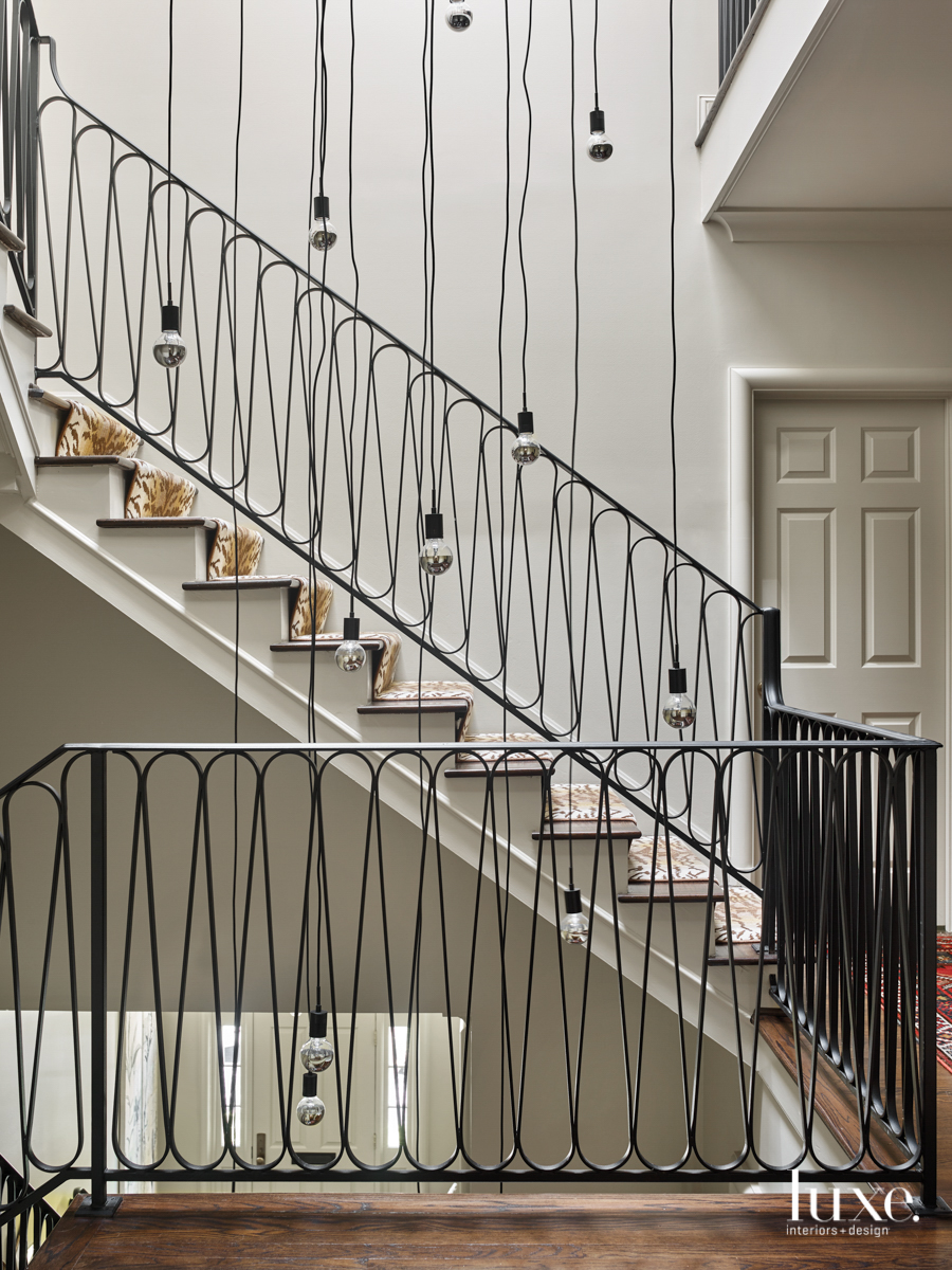 staircase with decorative iron railing...