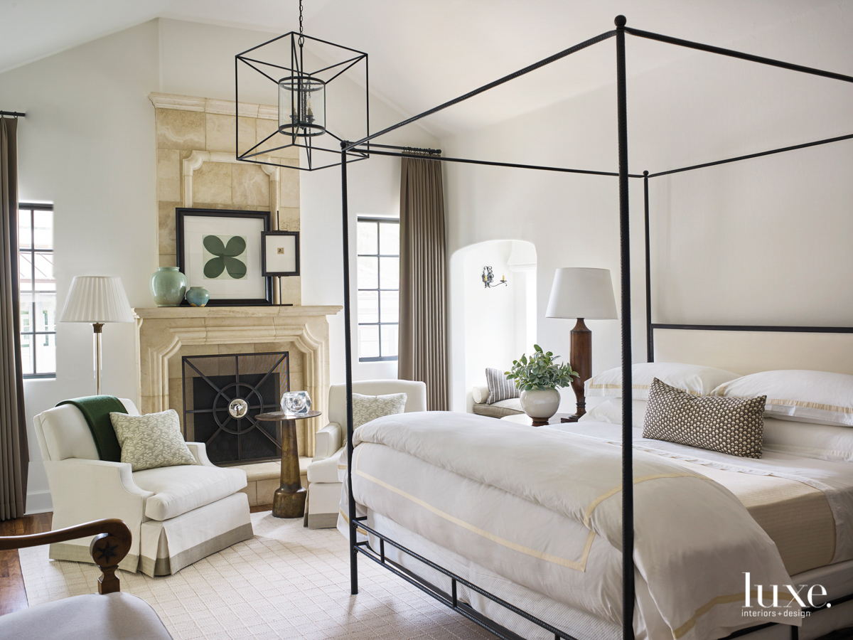 master bedroom featuring a chandelier,...