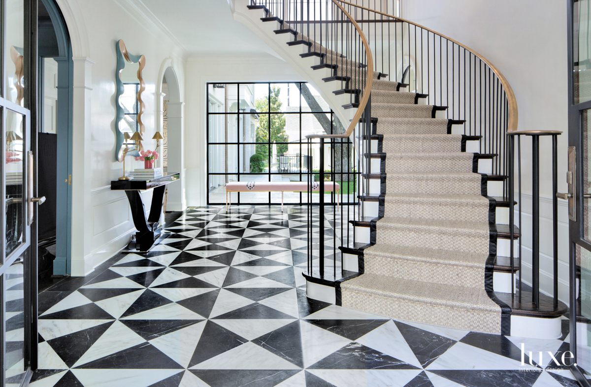 Entryway with black and white...