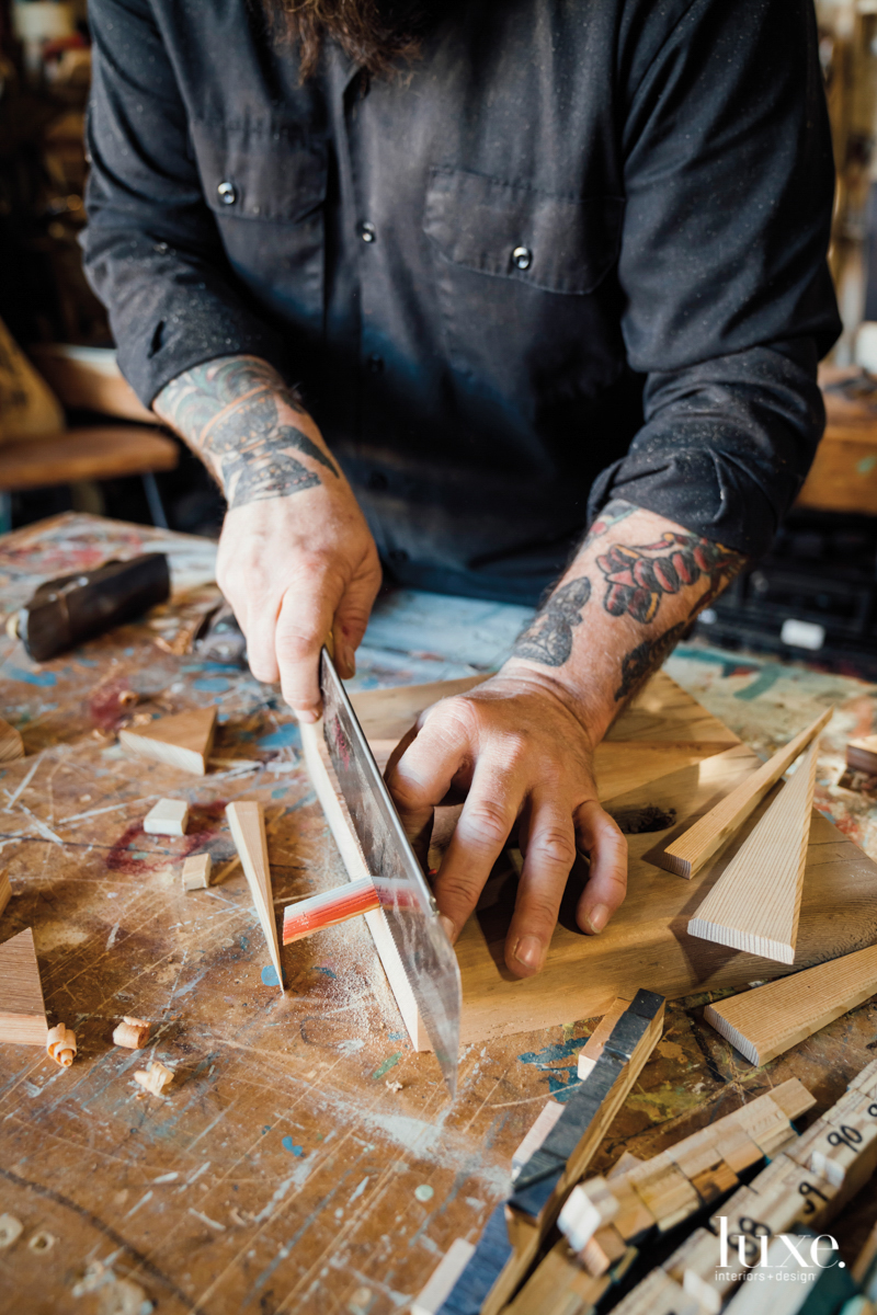 Aaron Michalovic working in his studio