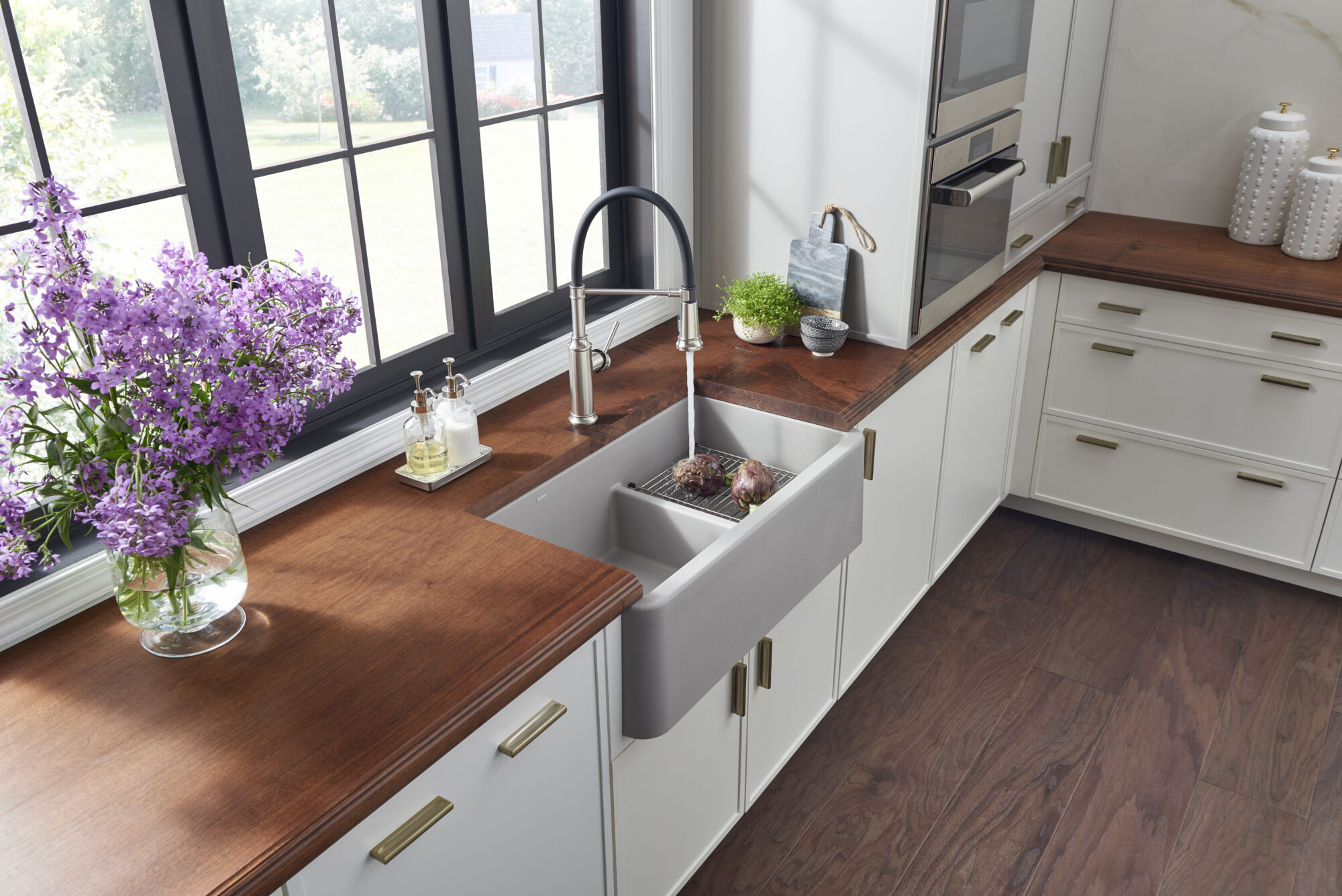 blanco grey sink with running water