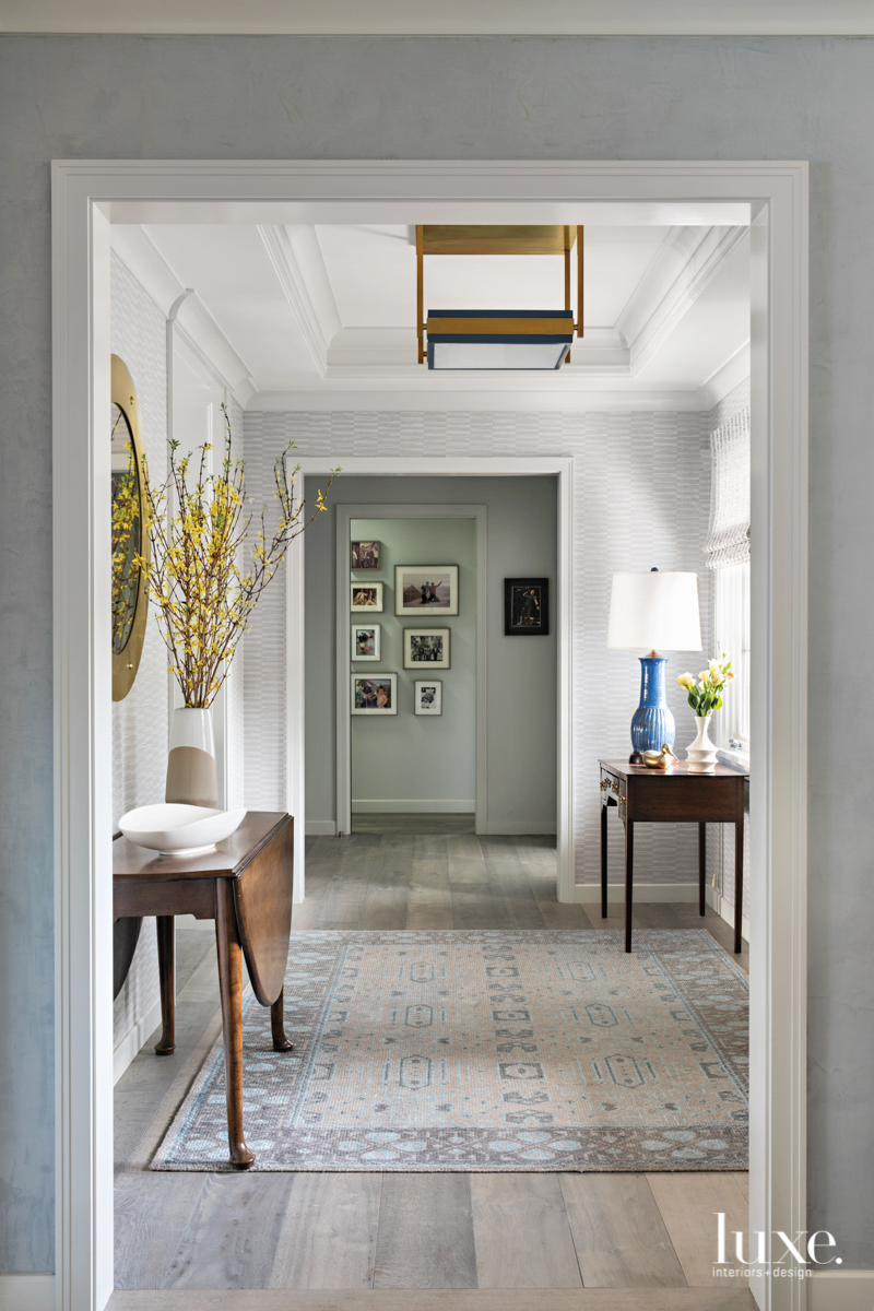 entry wiith philip jeffries wallcovering and heirloom tables