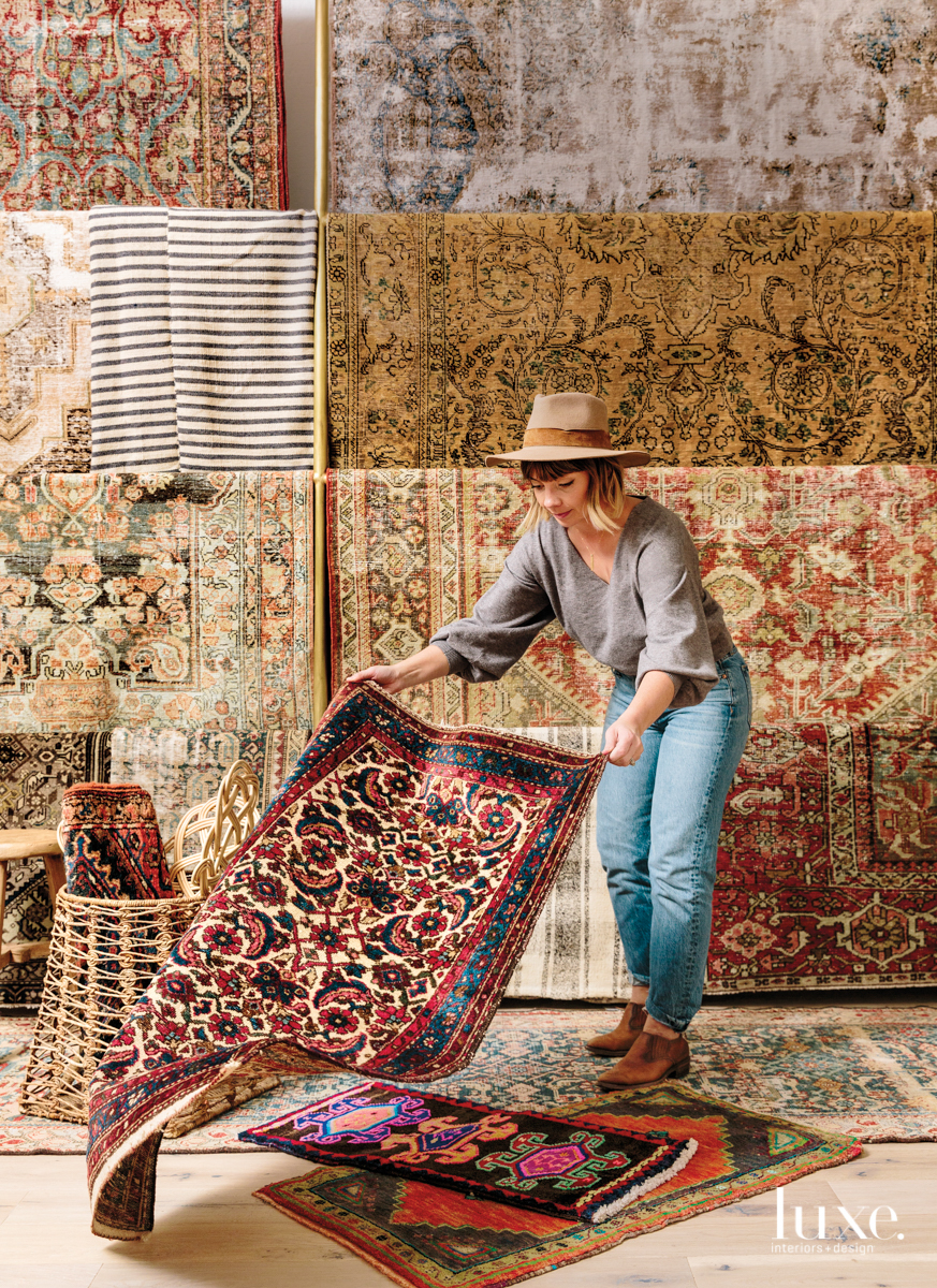 Brittany Chinaglia in front of vintage rugs