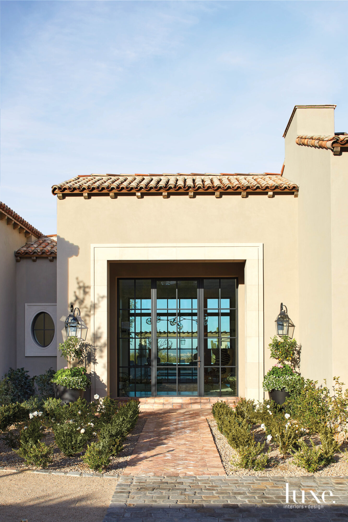 Landscaping frames the entrance to...
