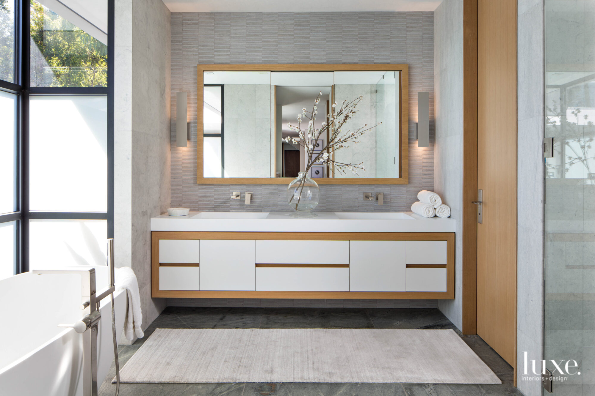 Master bathroom facing vanity and...