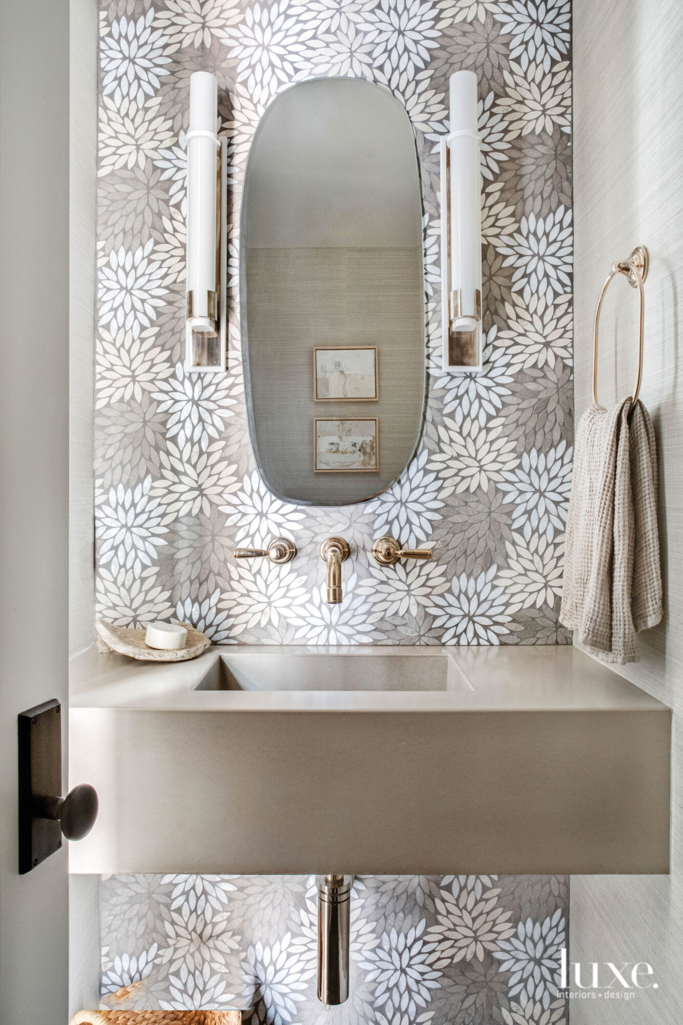 Powder room with mosaic tile...