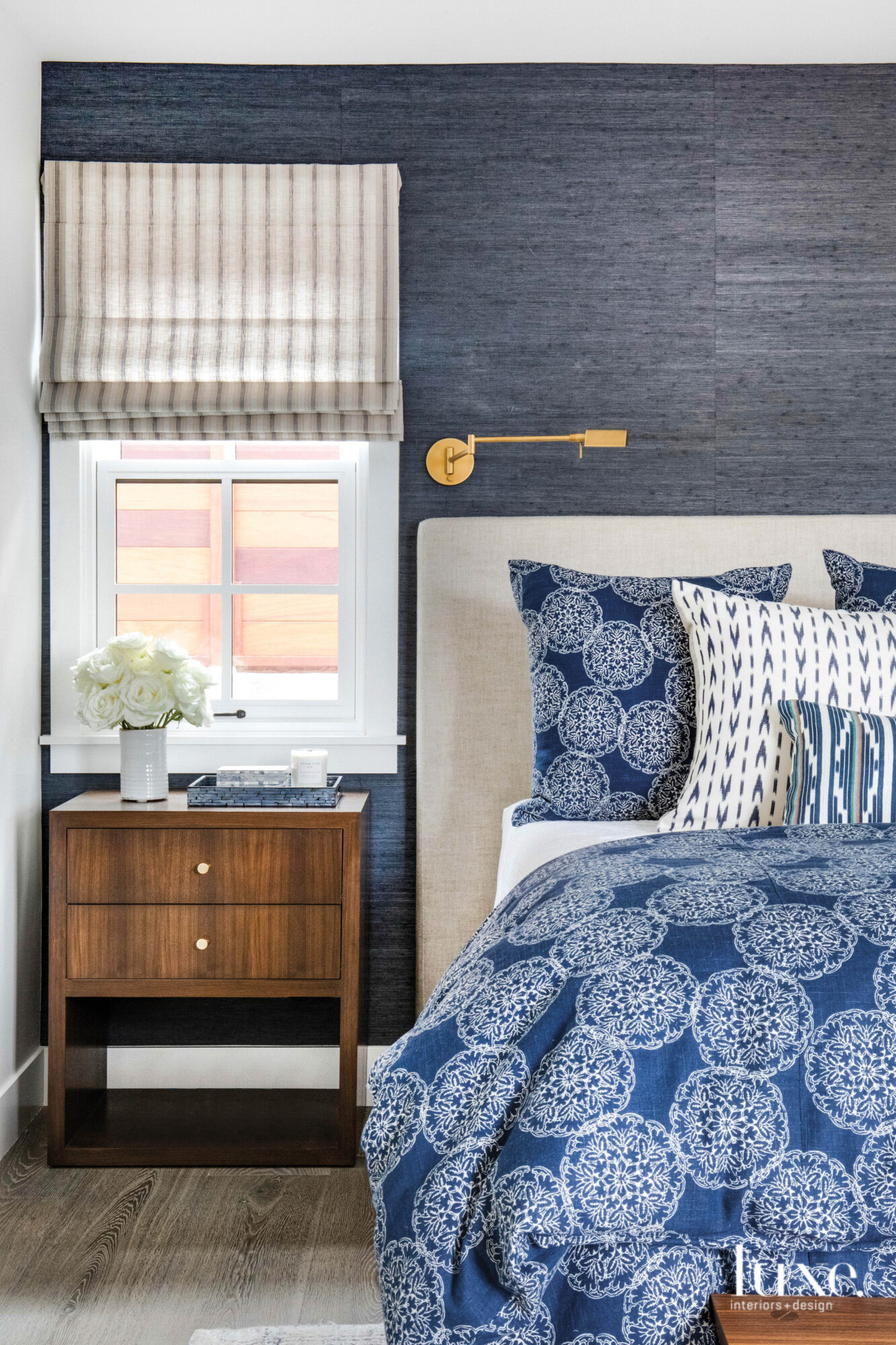 Bedroom shot with grasscloth covered...