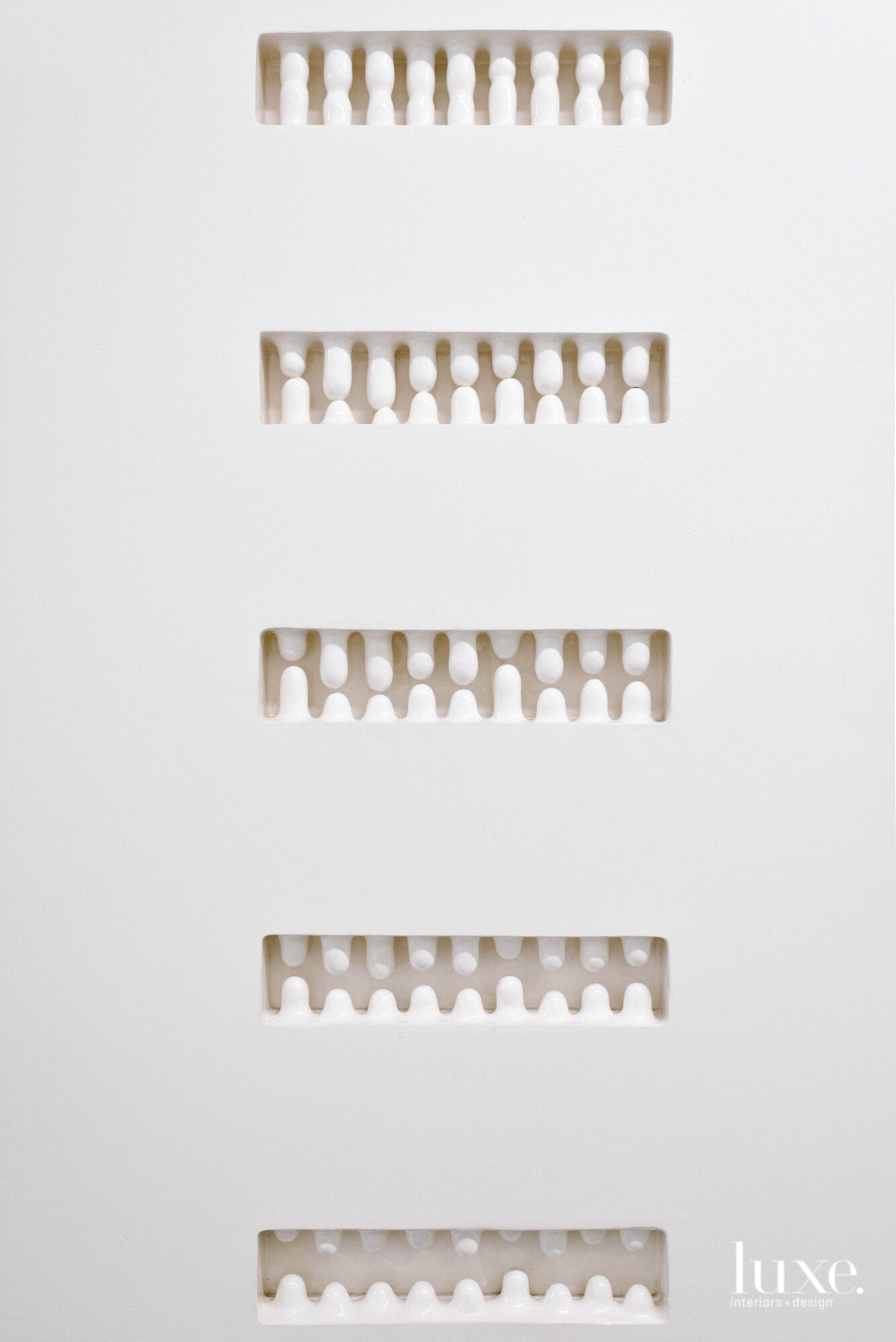 Ceramic pieces inset into a wall