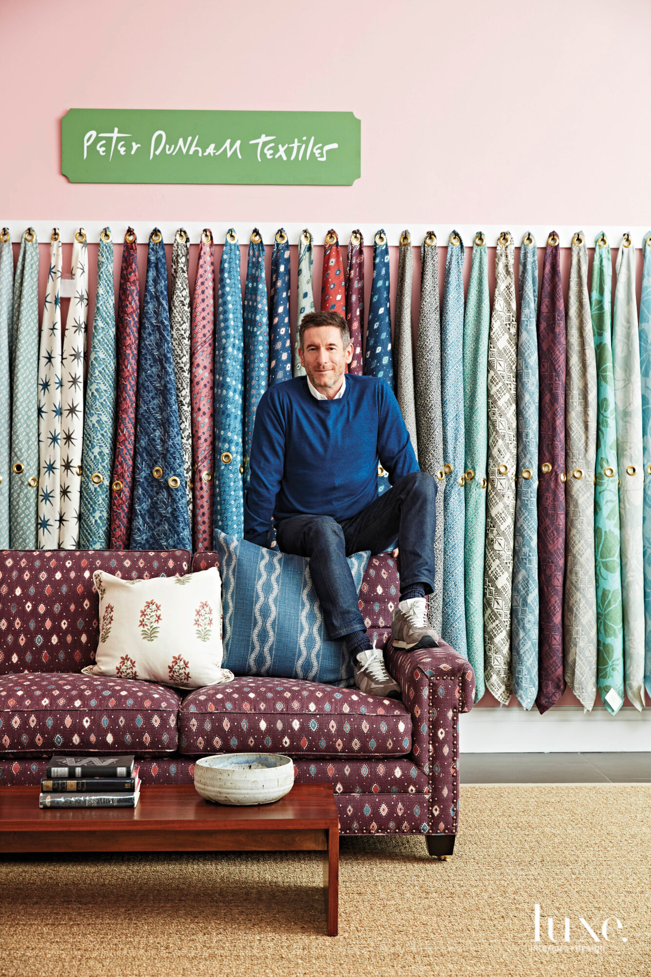 Peter Dunham in front of fabrics