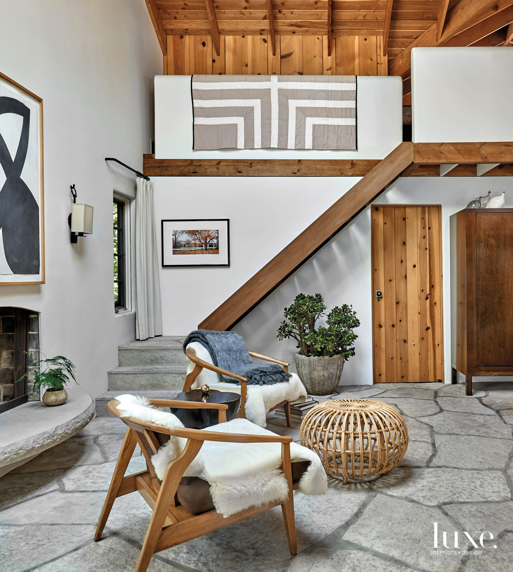 White walls and wood and stonework features dominate this cozy seating area.