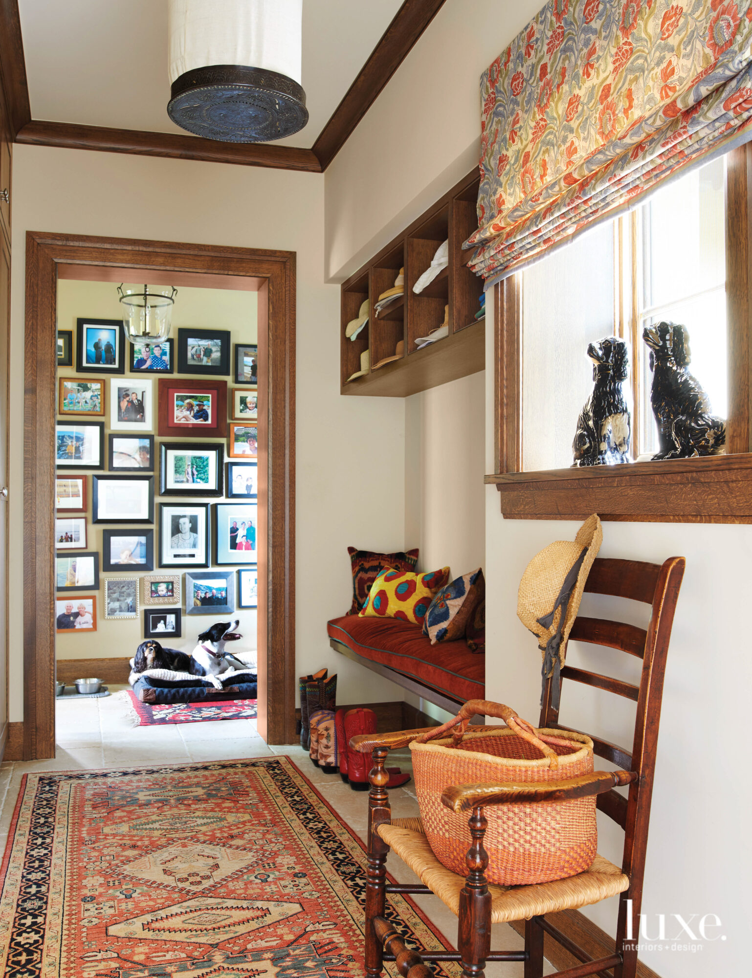 A mudroom features a bench and antique chair.