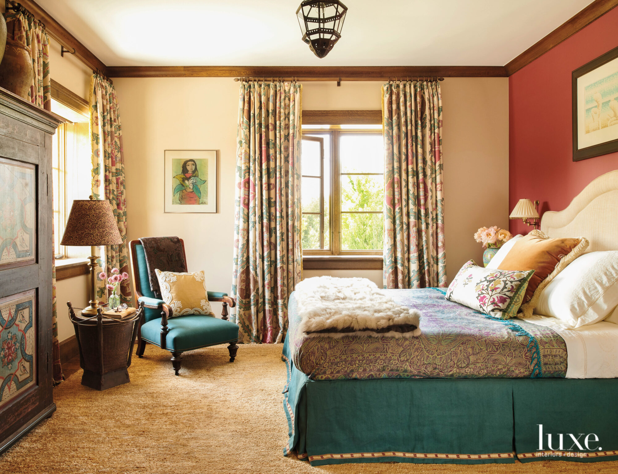 A guest room has richly...