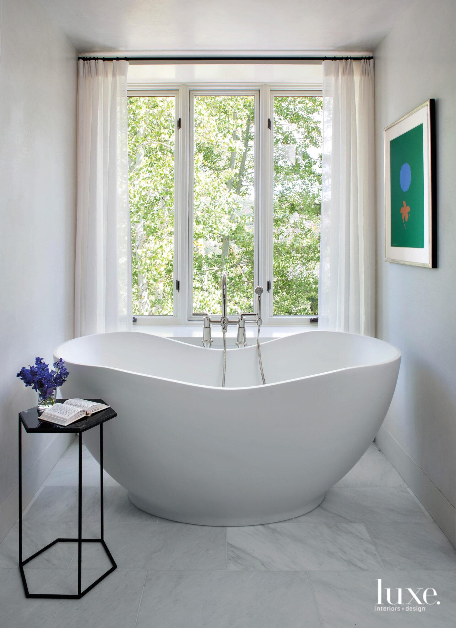 A curvy tub sits in...