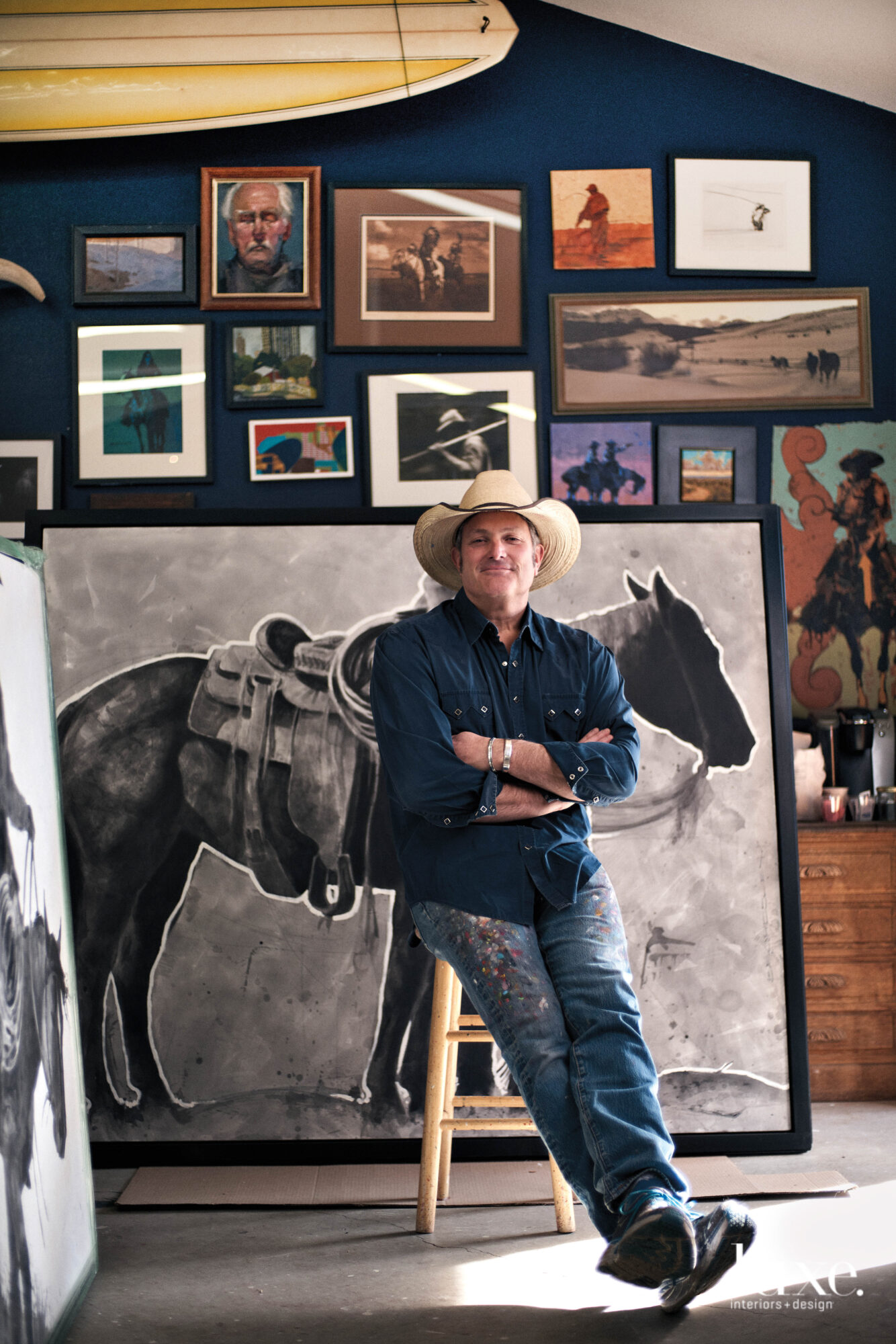 Artist Duke Beardsley relaxes in his art-filled studio.