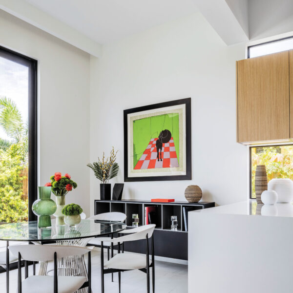 In A Sleek Miami Abode, Warm Materials And Pops Of Color Exude That Cozy Feeling Of Home