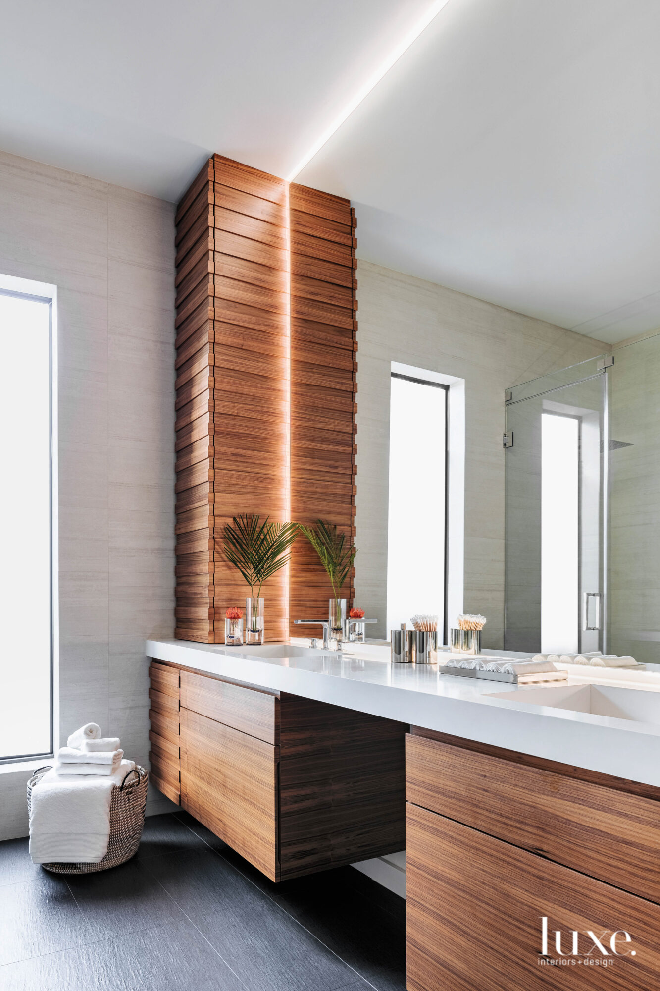 Bathroom with walnut cabinetry and...