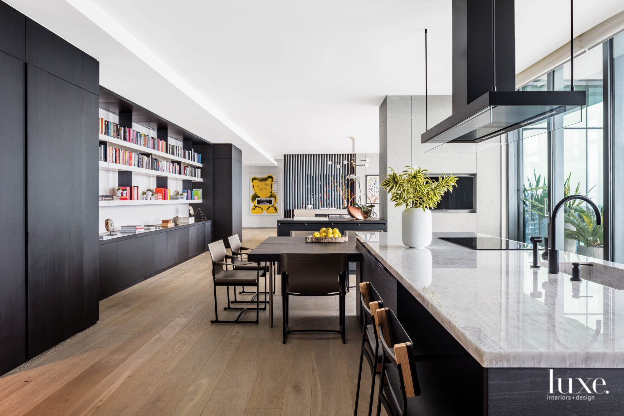 A modern, dark-toned kitchen with...