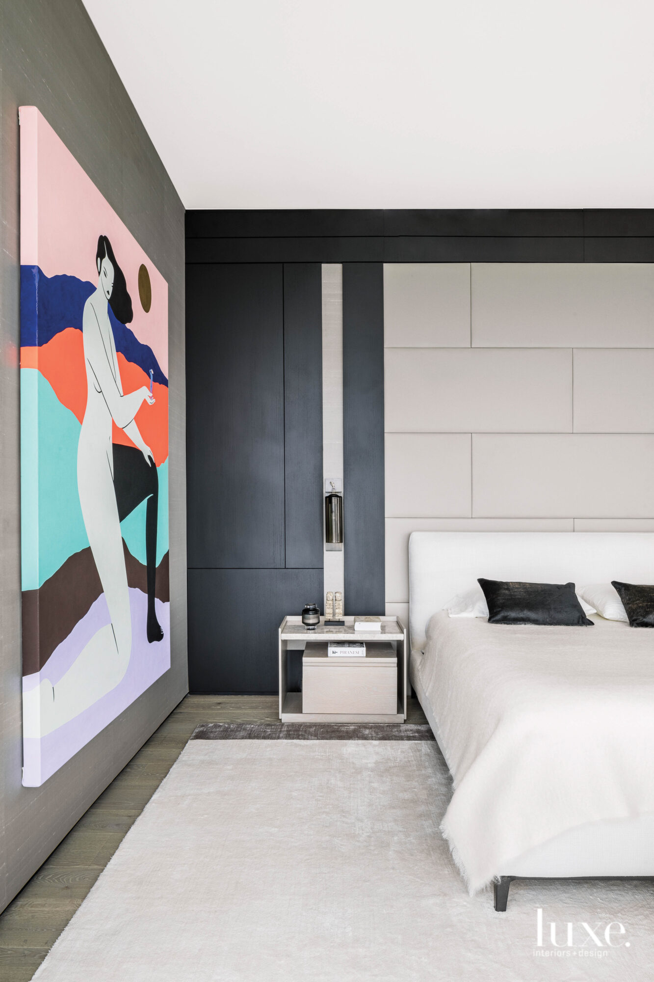 Master bedroom with colorful artwork...