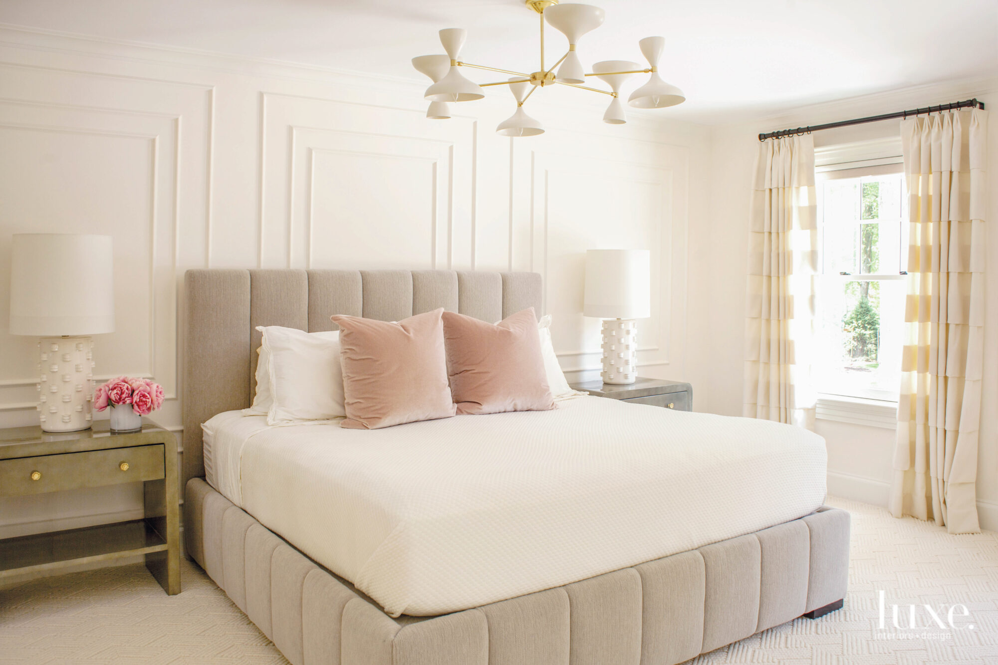 Neutral bedroom with upholstered bedframe