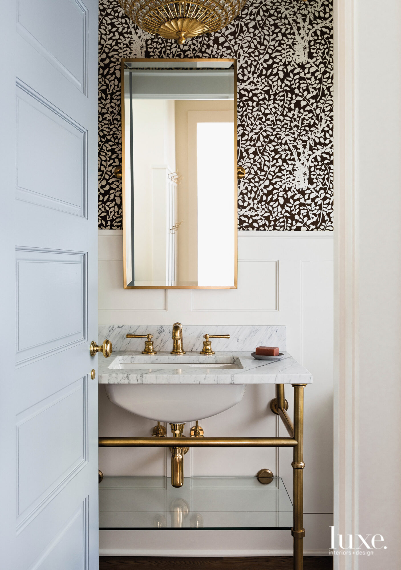 Powder room with a black...