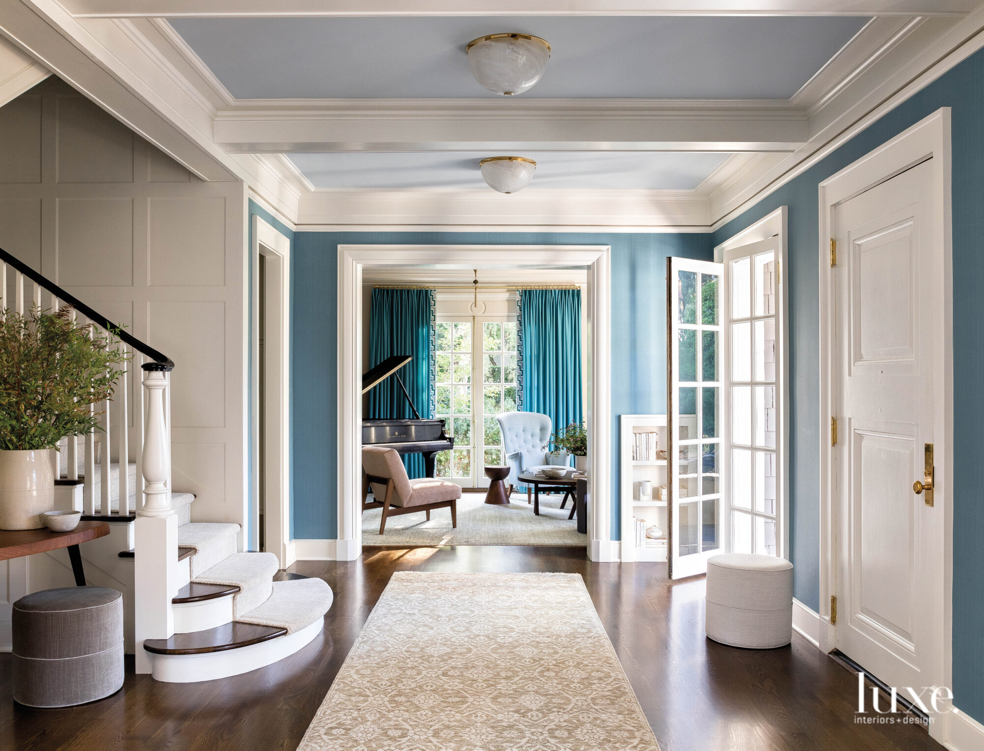 A bright, blue-painted entry looking...