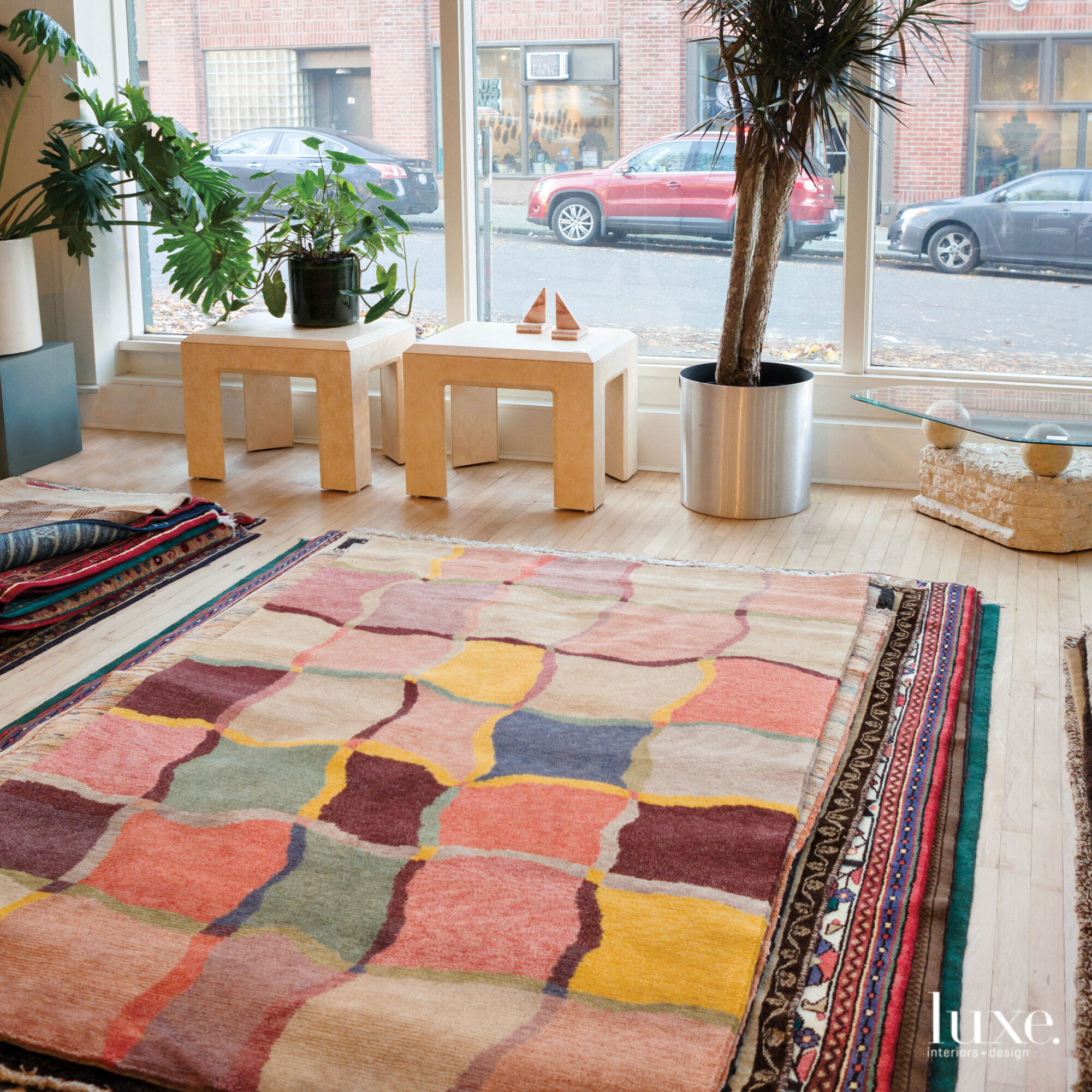 A colorful patterned rug sits center stage in this shop