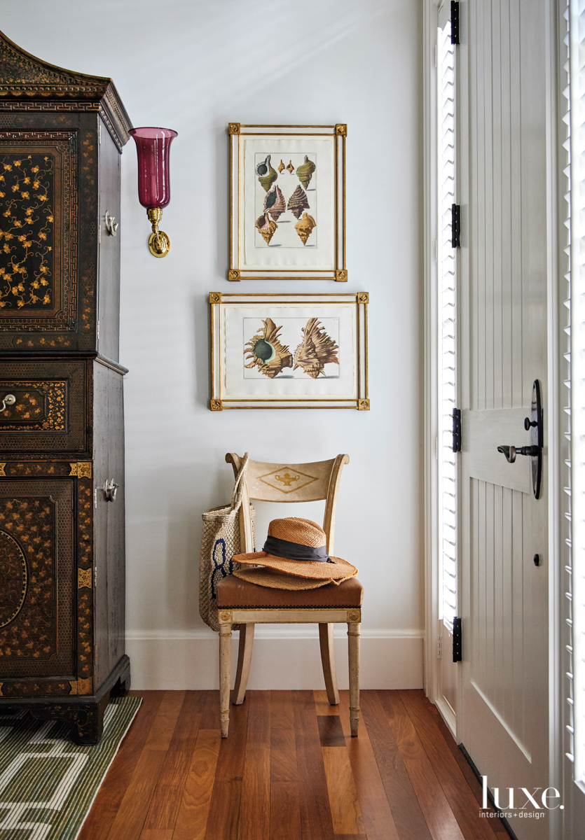 foyer with antique chair