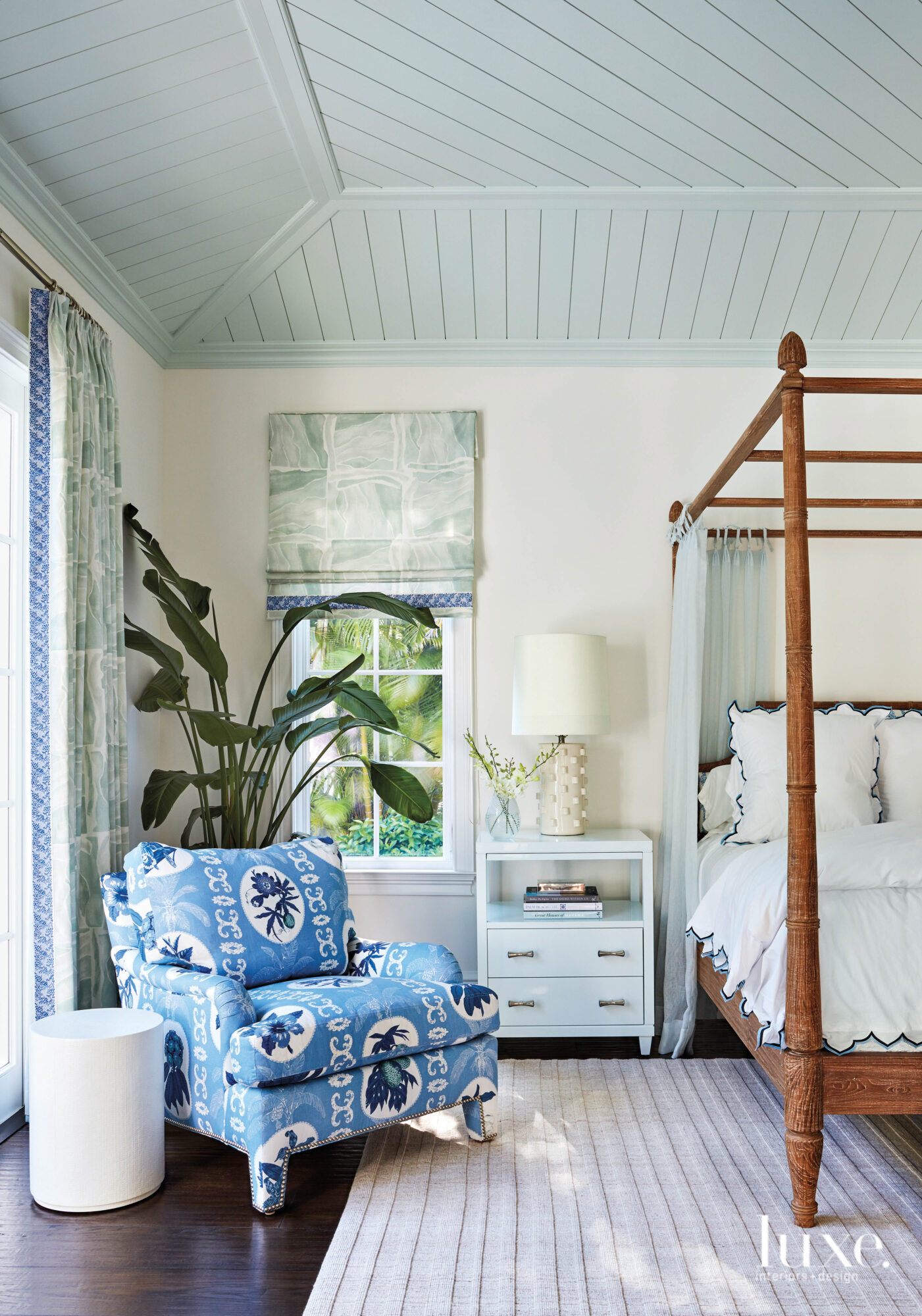 Bedroom with blue armchair and...