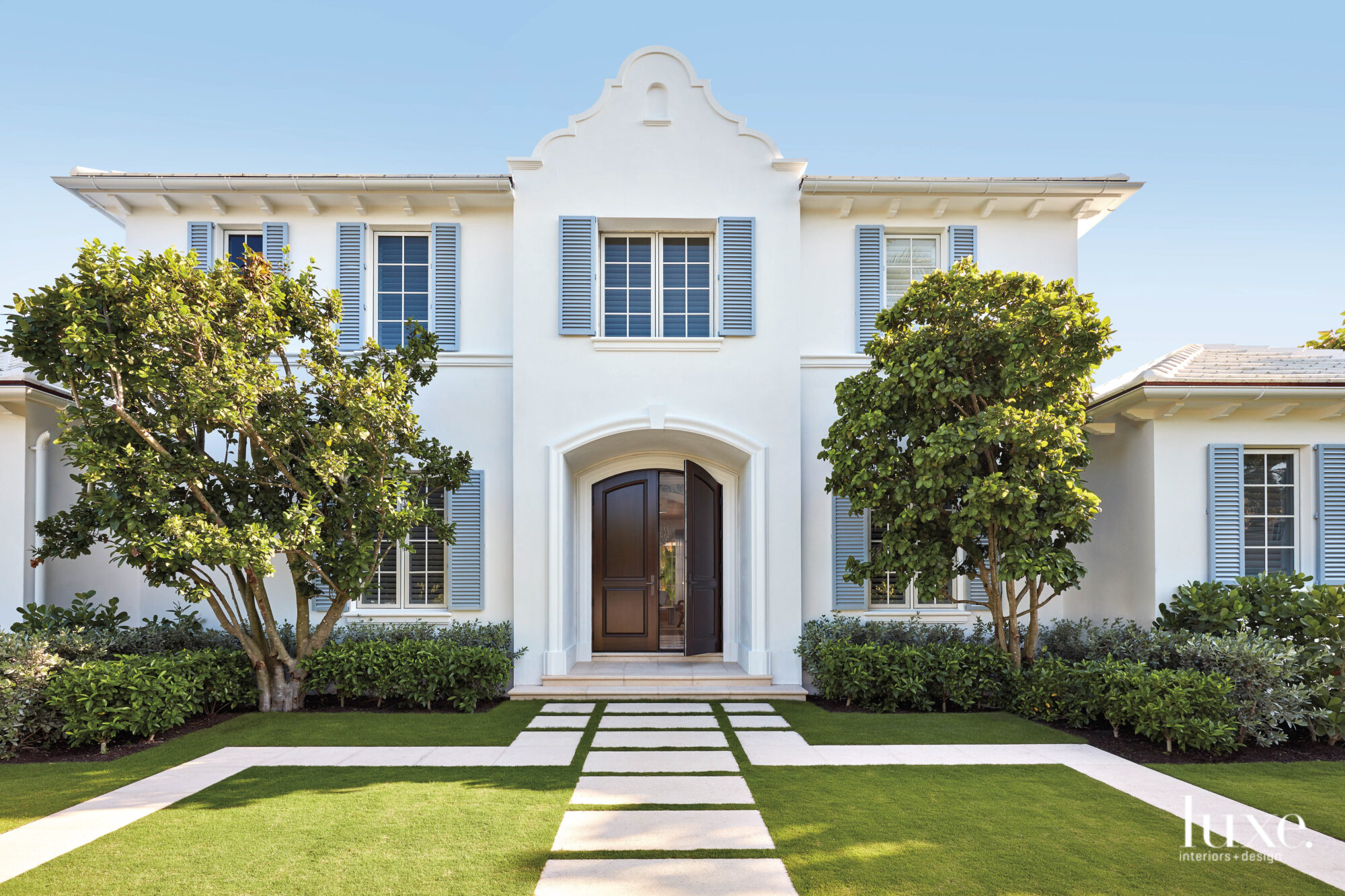 Exterior of white home with...