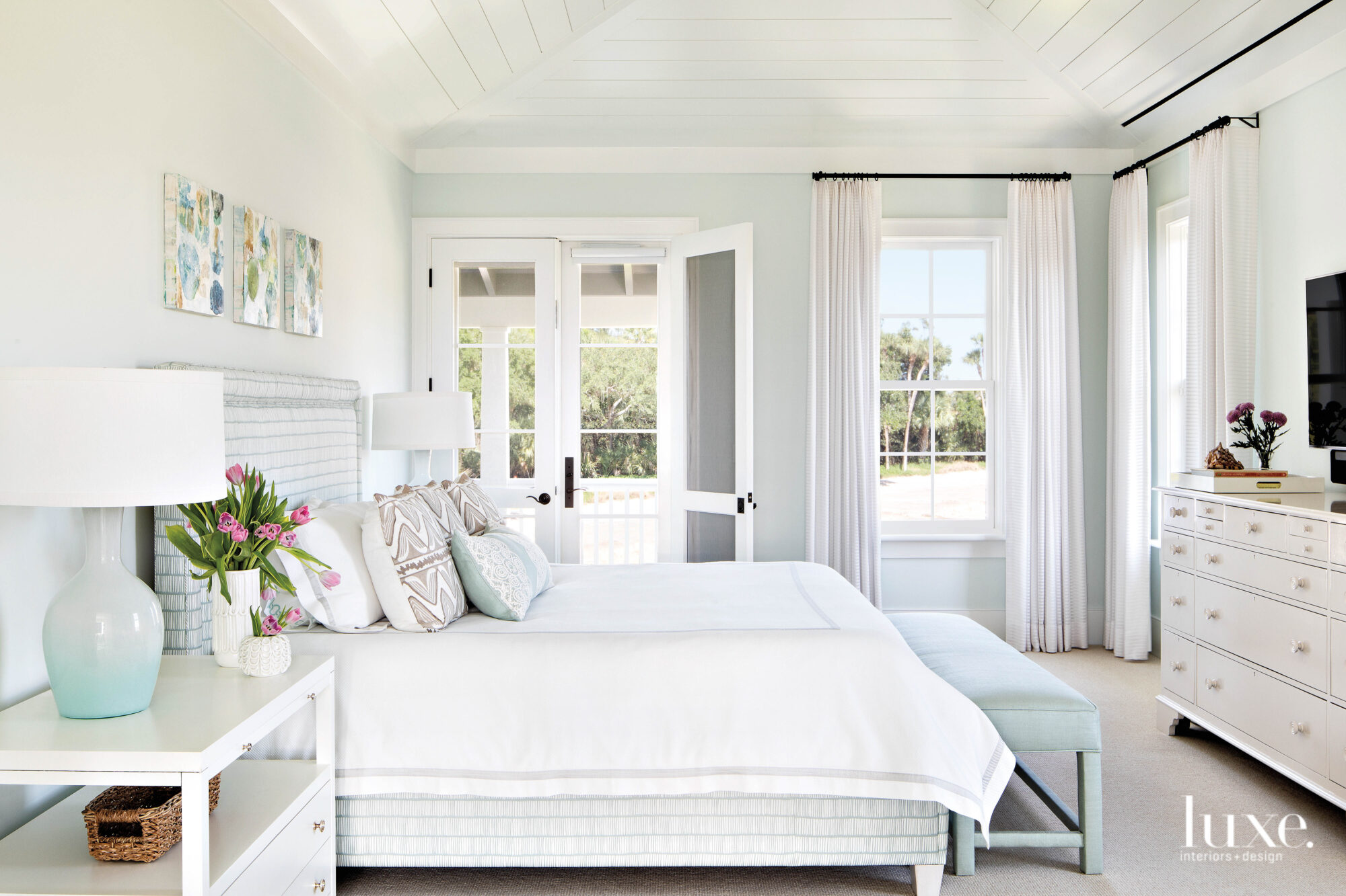 Bedroom with white linens and...