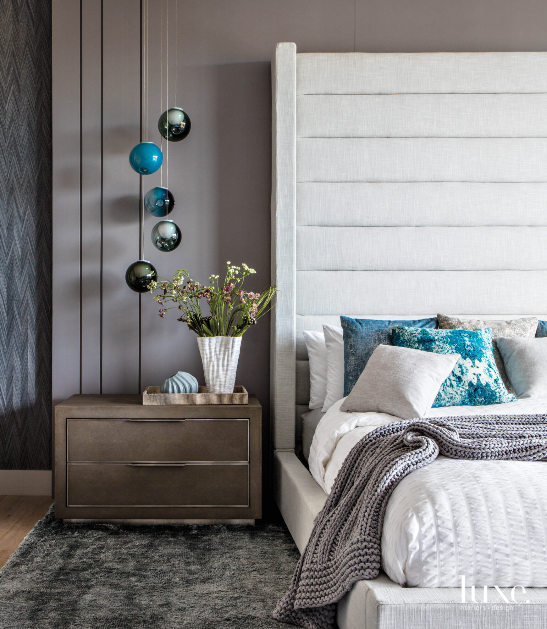 Bedroom with upholstered headboard and...