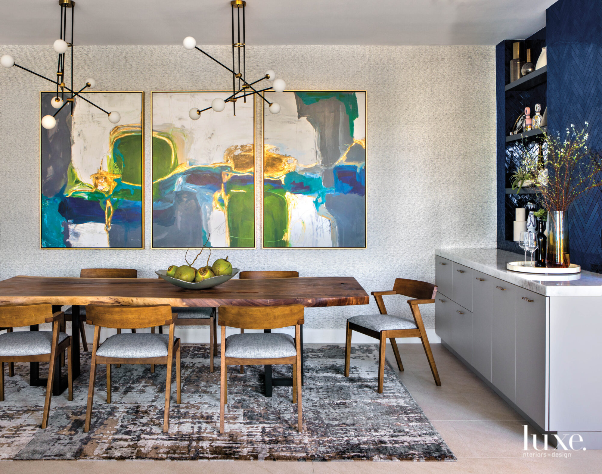 Dining room with jewel-tone artwork...