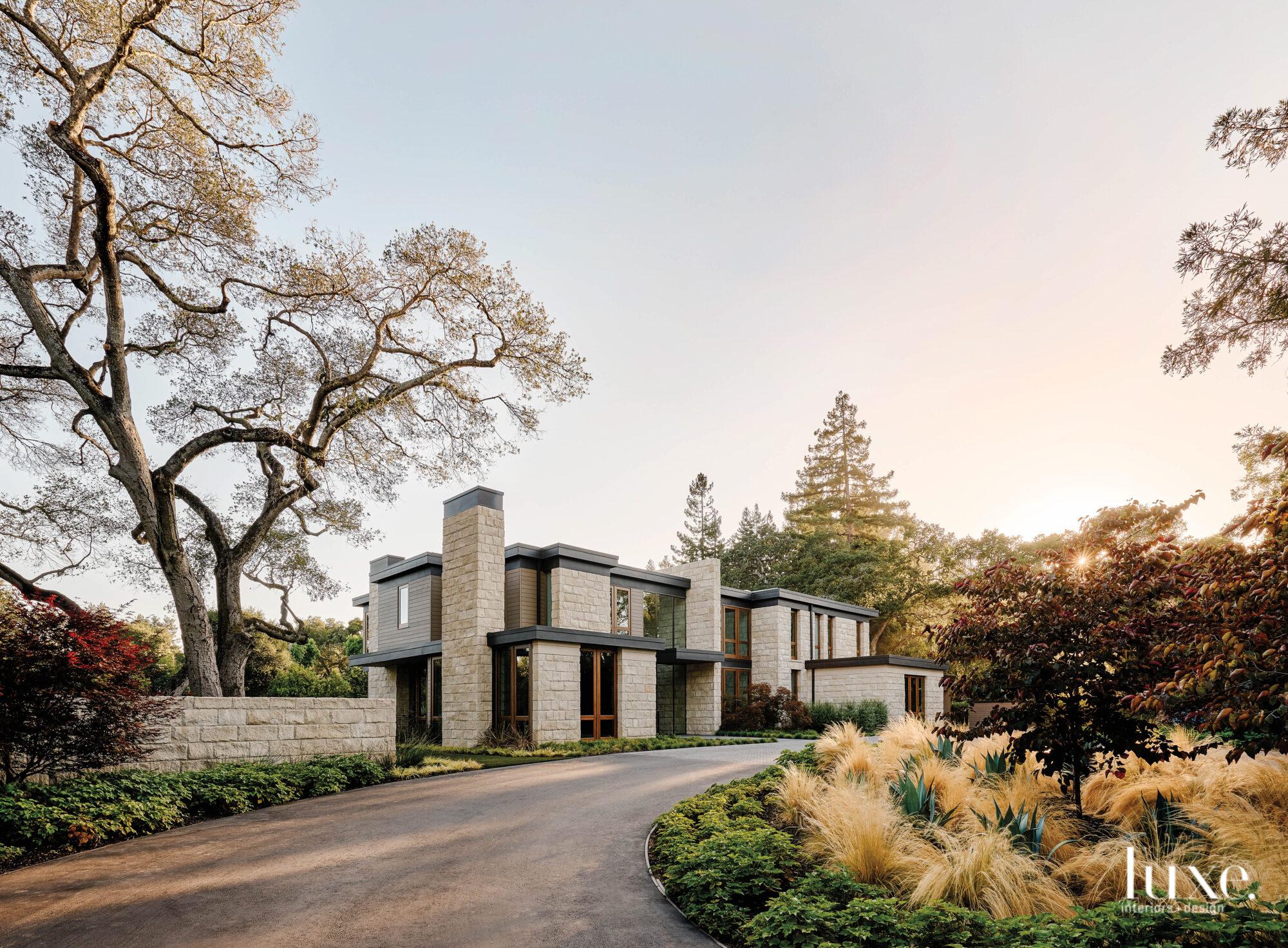 A modern house sits amidst...