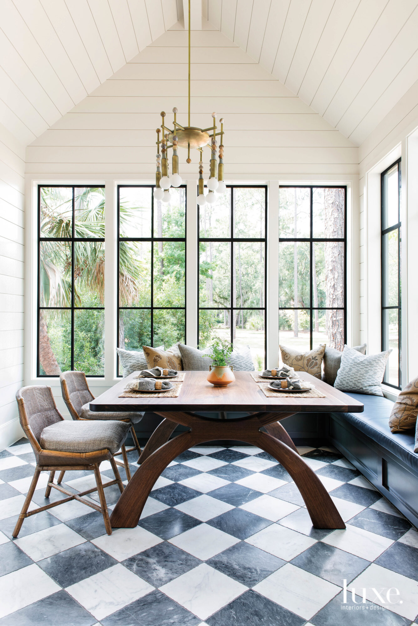 Dining table surrounded by windows...