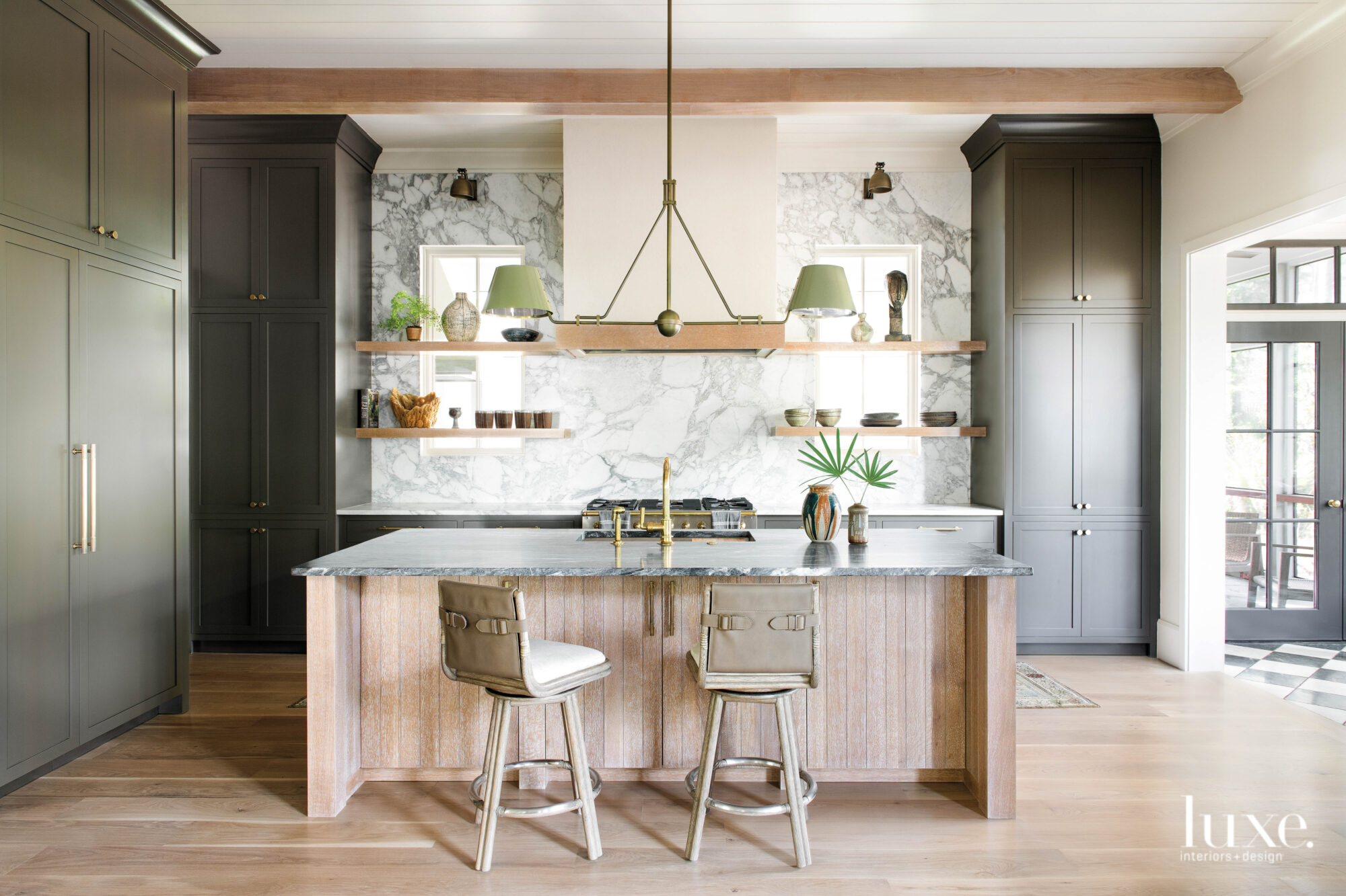 Kitchen with marble backsplash and...