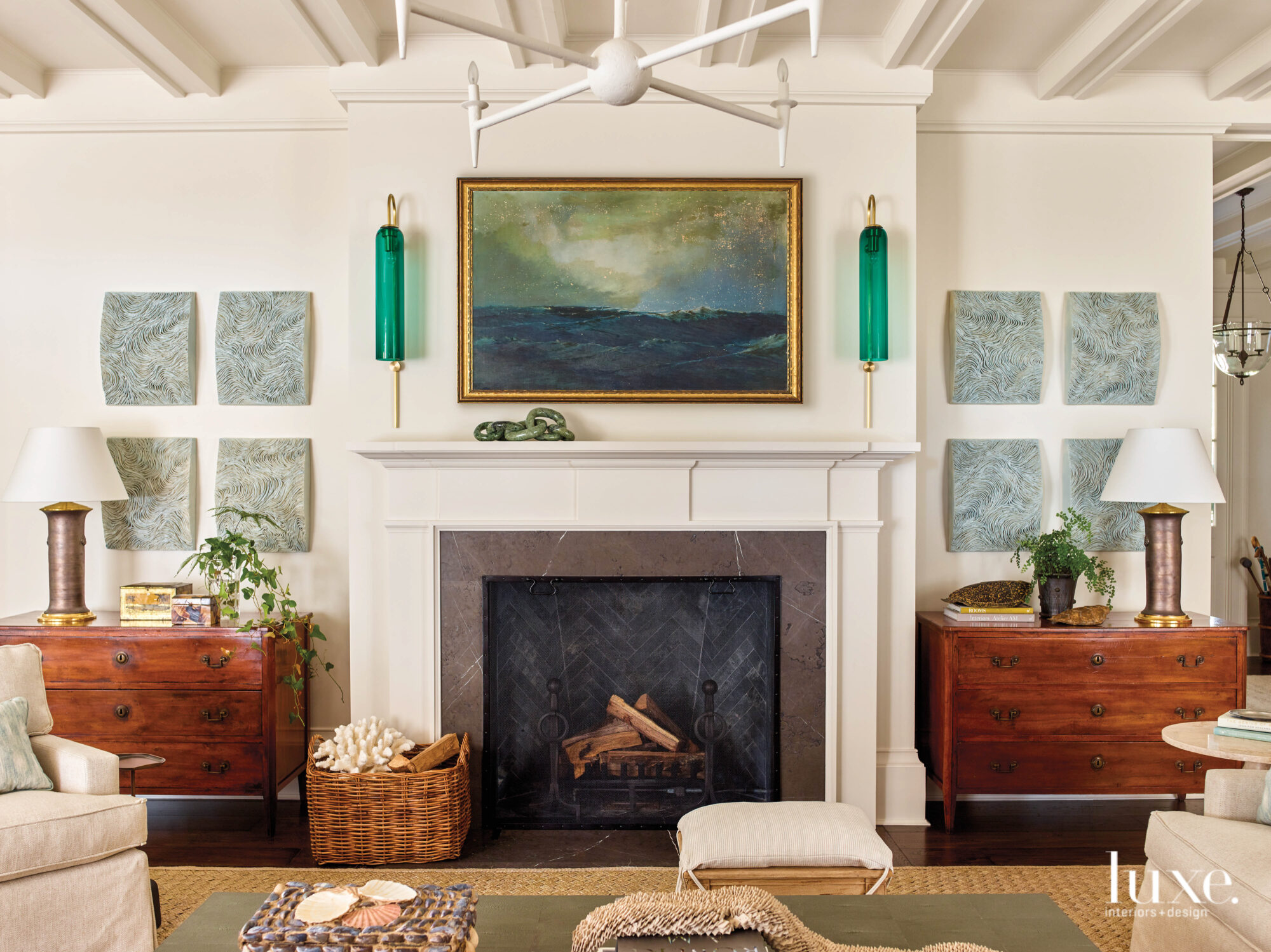 Fireplace with green sconces and...