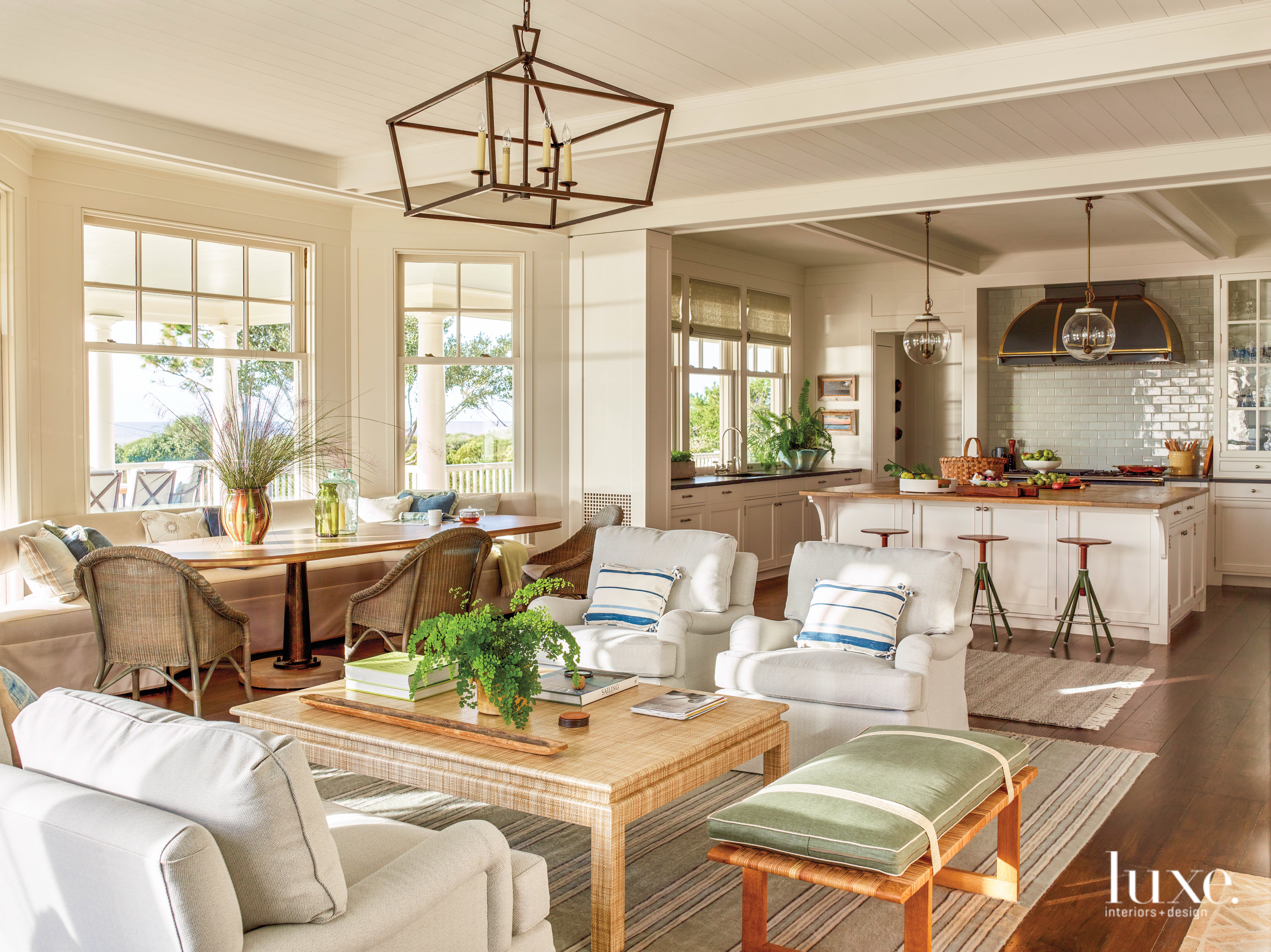 Armchairs surrounding coffee table with...