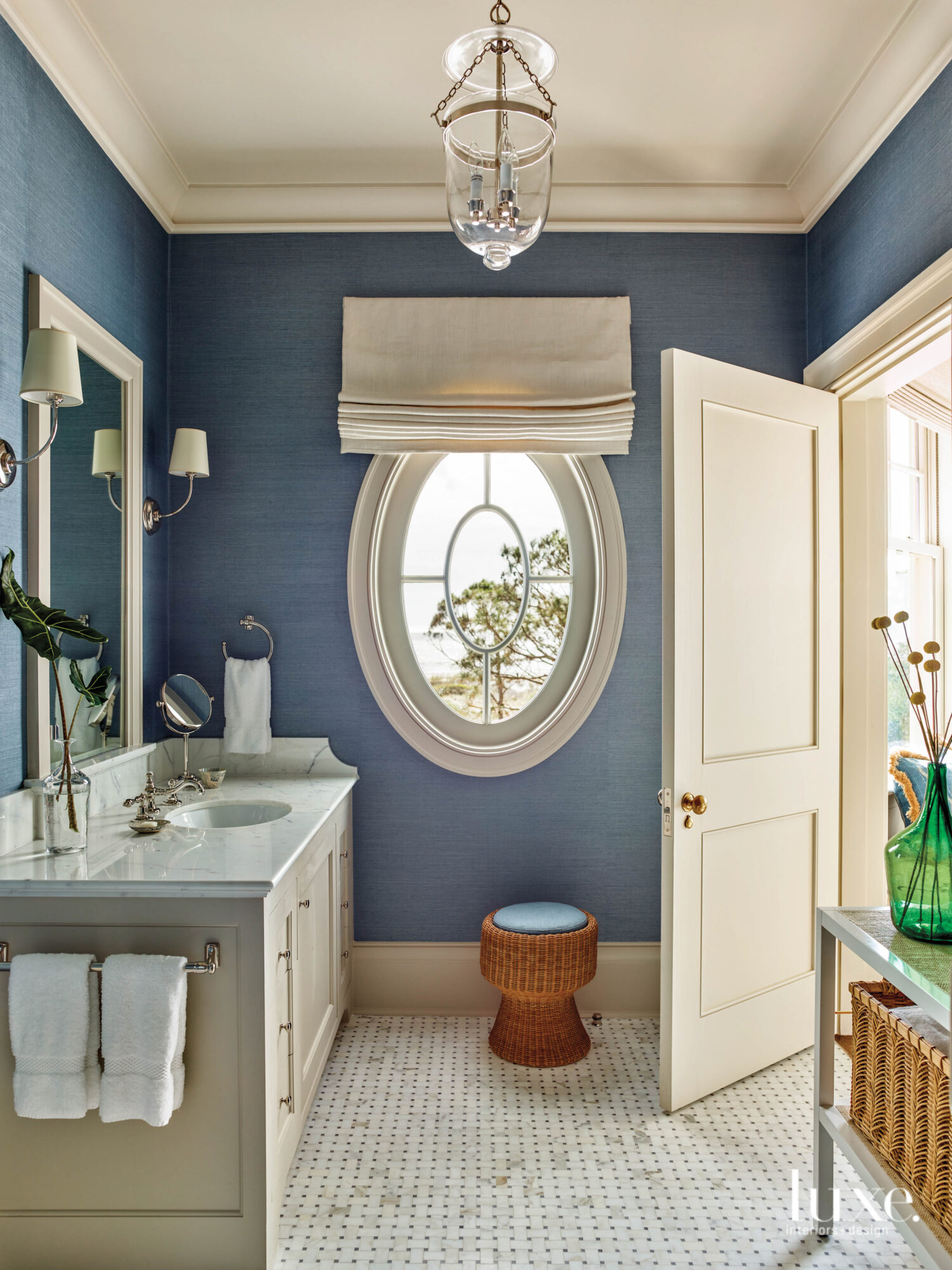 Bathroom with oval window and...