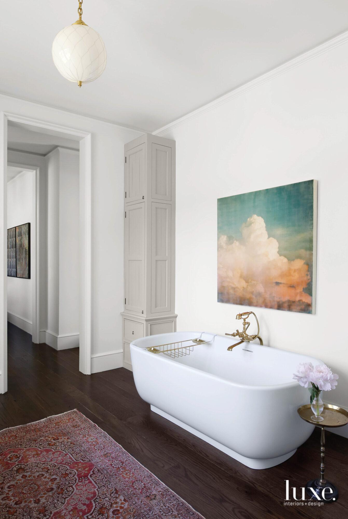 A bathtub, wood floors, pink...
