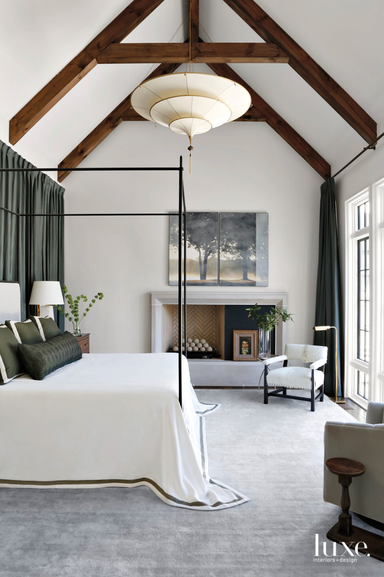 A canopy bed draped with...