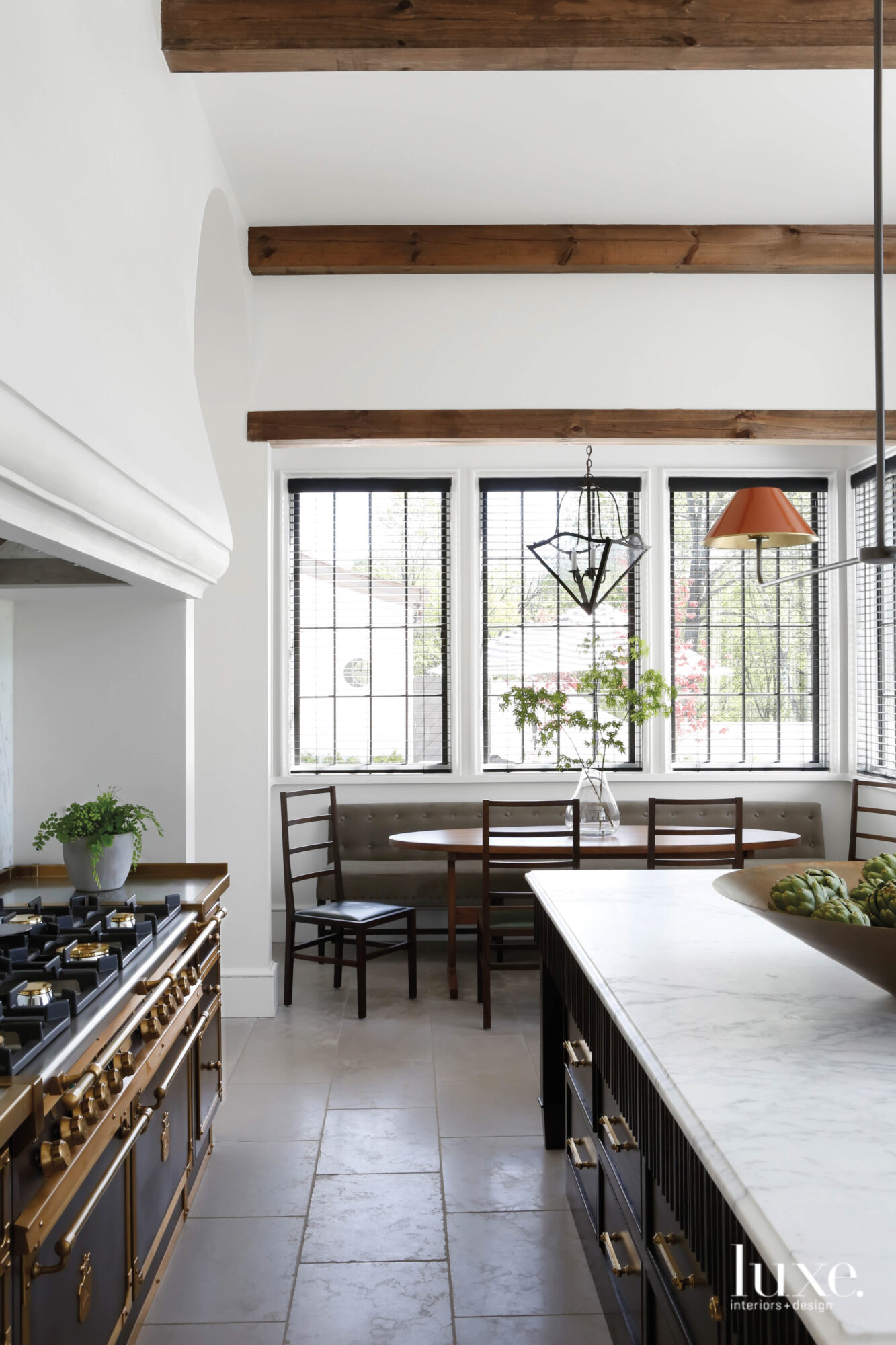A kitchen featuring limestone floors,...