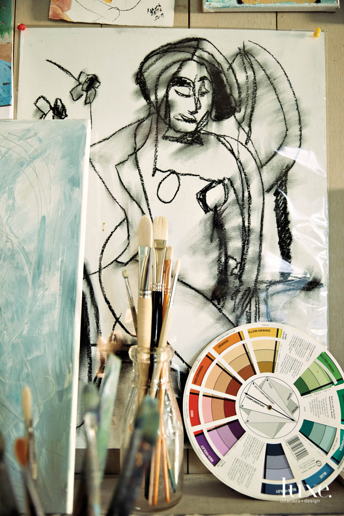 Charcoal drawing with paint brushes and color wheel