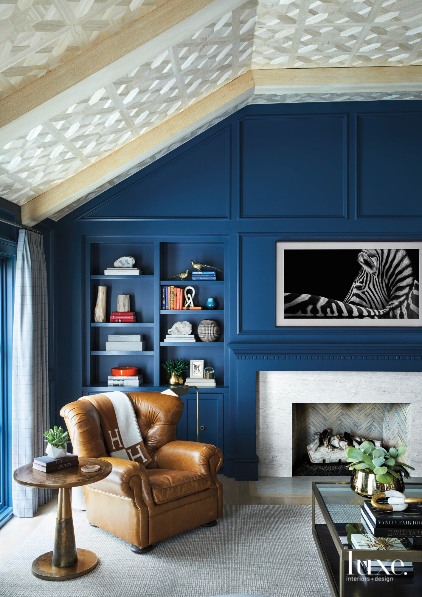 Den with blue paneled walls
