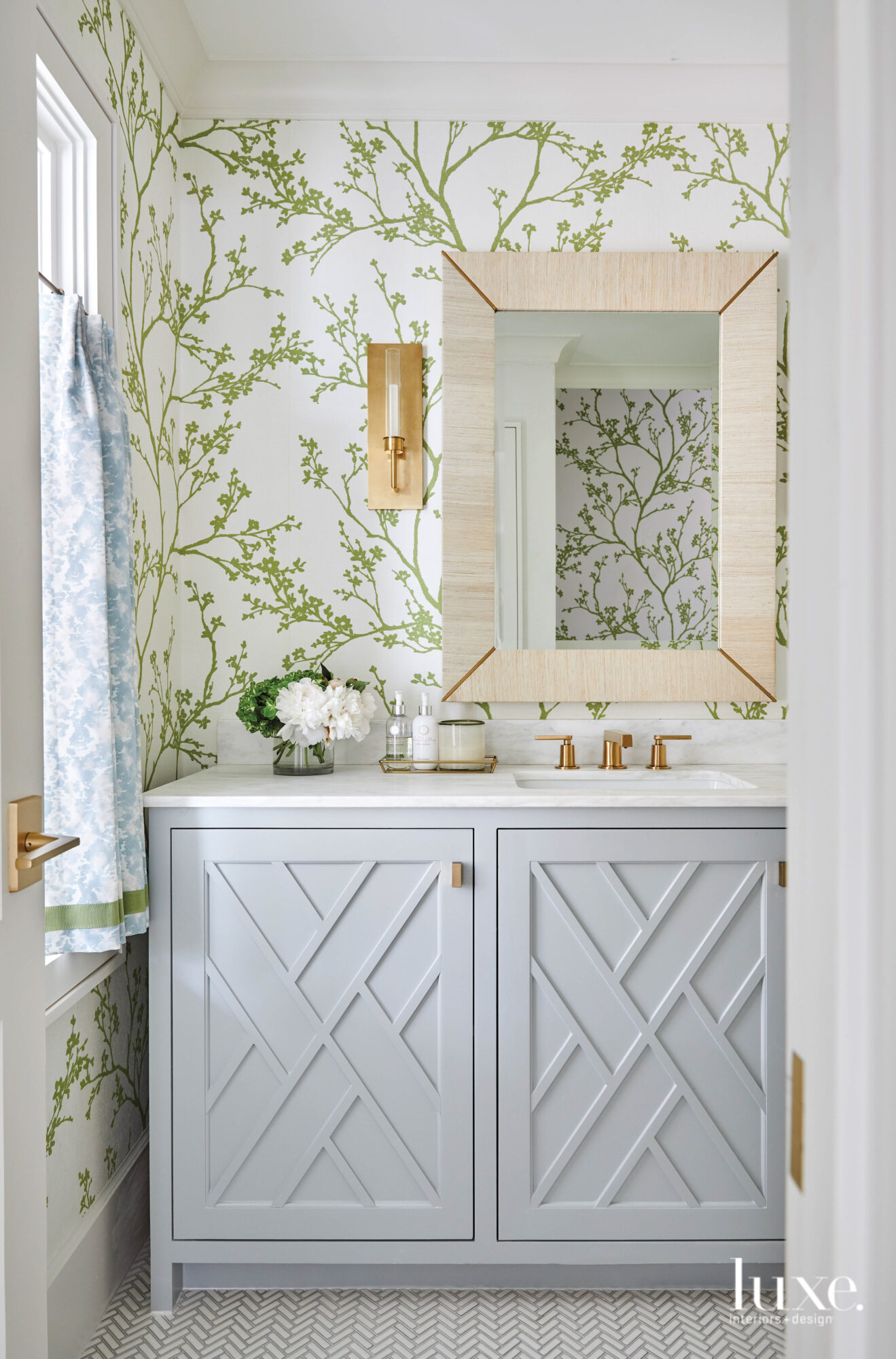 Powder bathroom with wallpaper