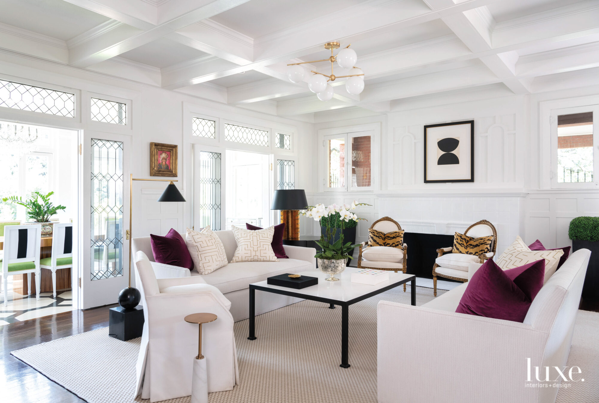 Living room with tailored furnishings and paneled cielings