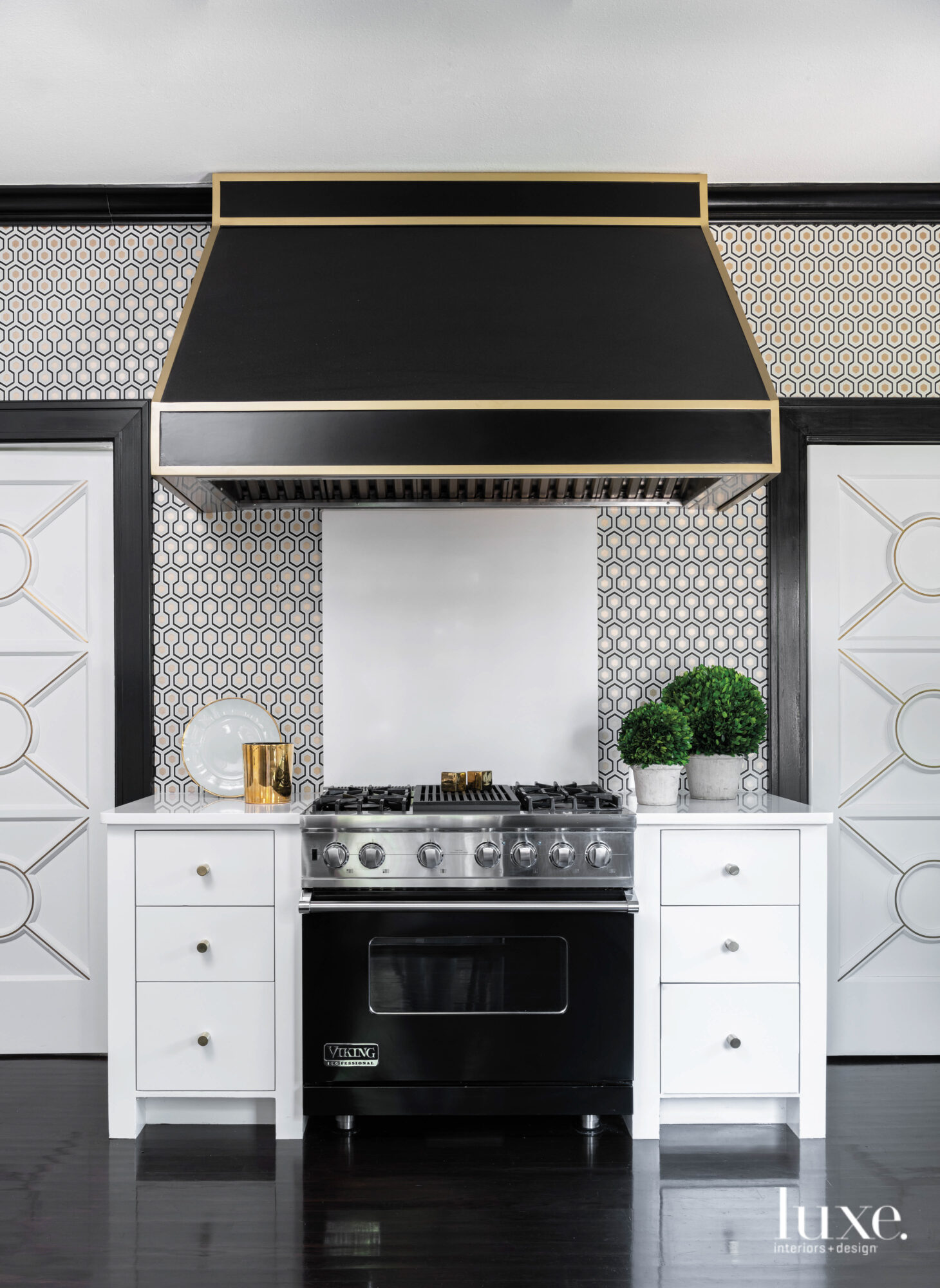 Kitchen with black and brass...