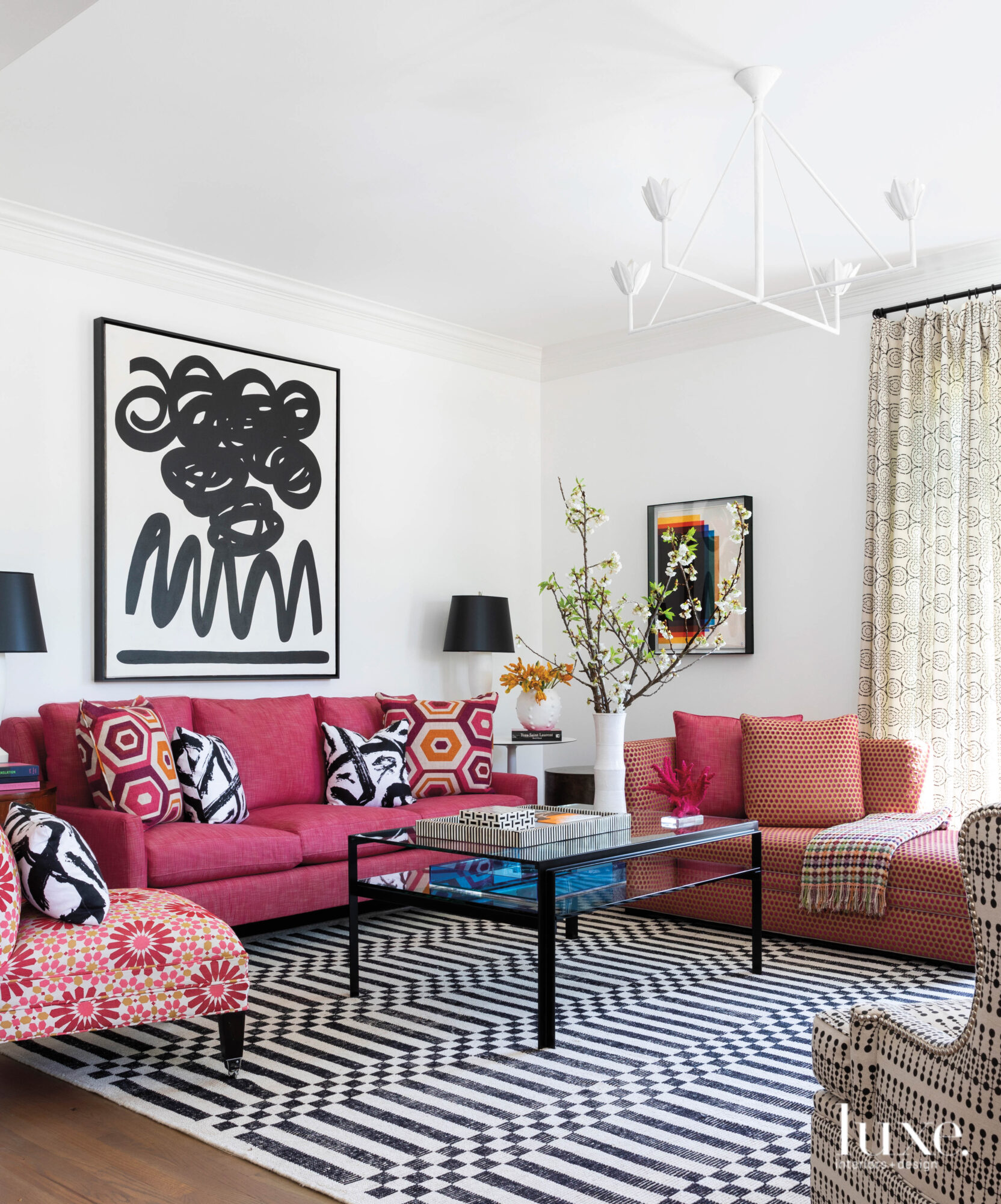 Sitting room with pink furnishings...