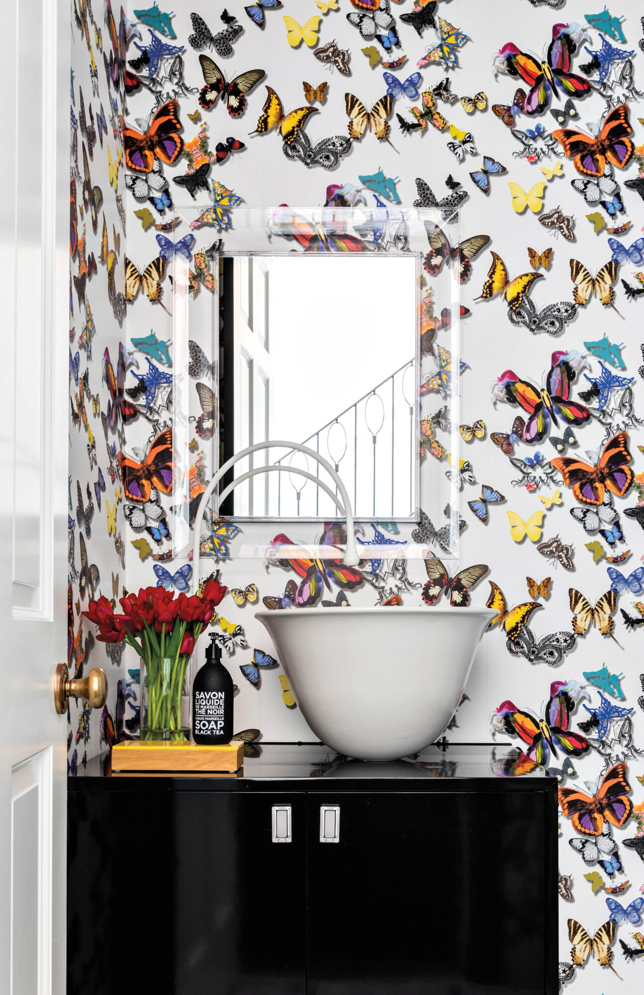 Powder bathroom with butterfly wallpaper...