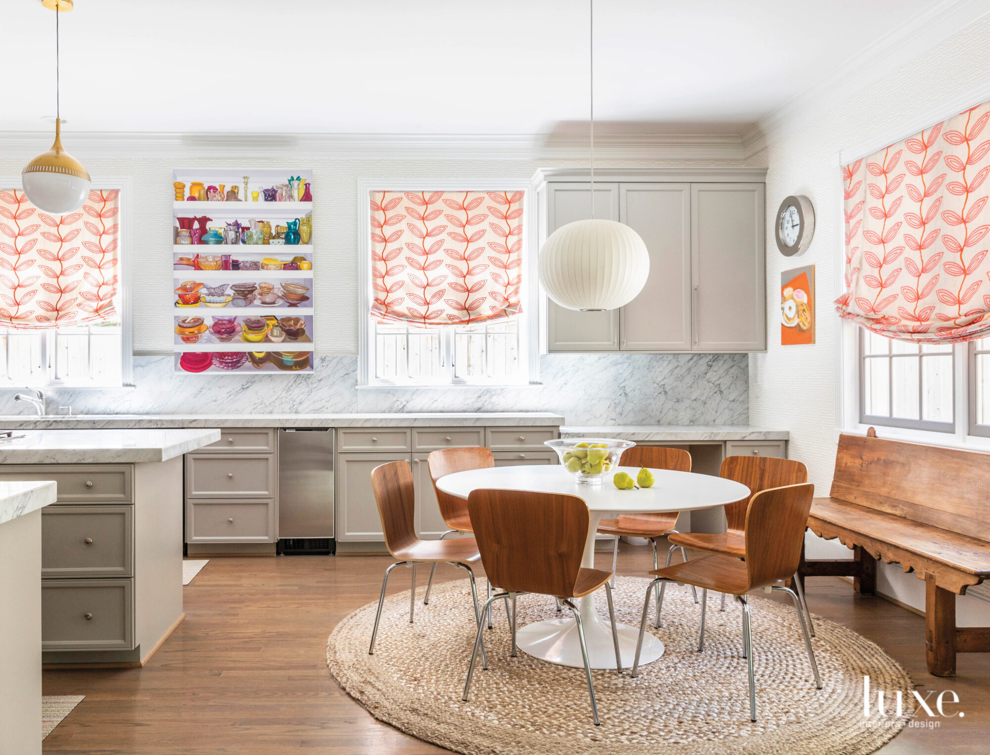 Round dining table in open kitchen full of colorful art